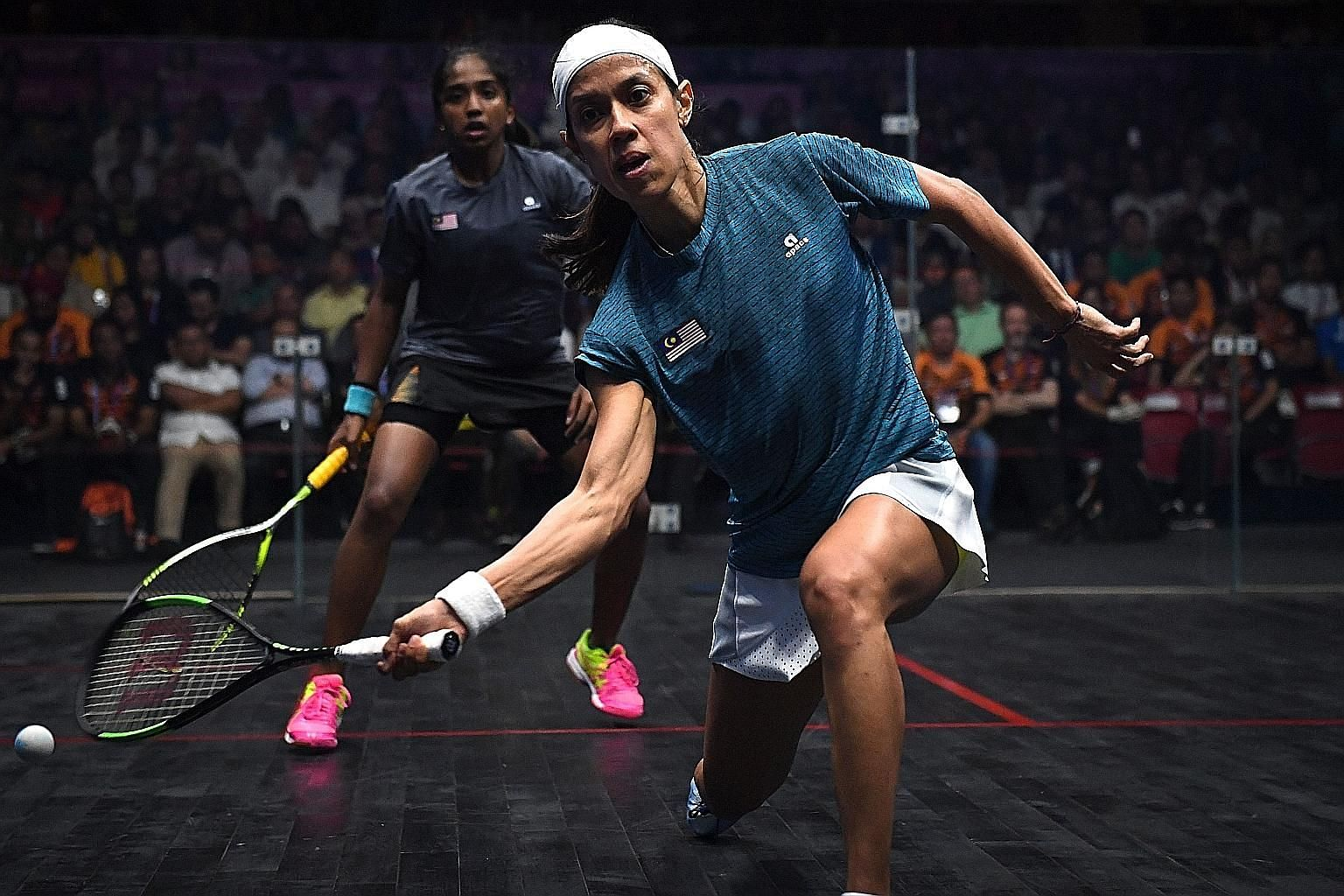 Nicol David returning a shot against fellow Malaysian Sivasangari Subramaniam in yesterday's final. She won 11-13, 11-9, 5-11, 11-6, 11-8 for her fifth Asiad gold.