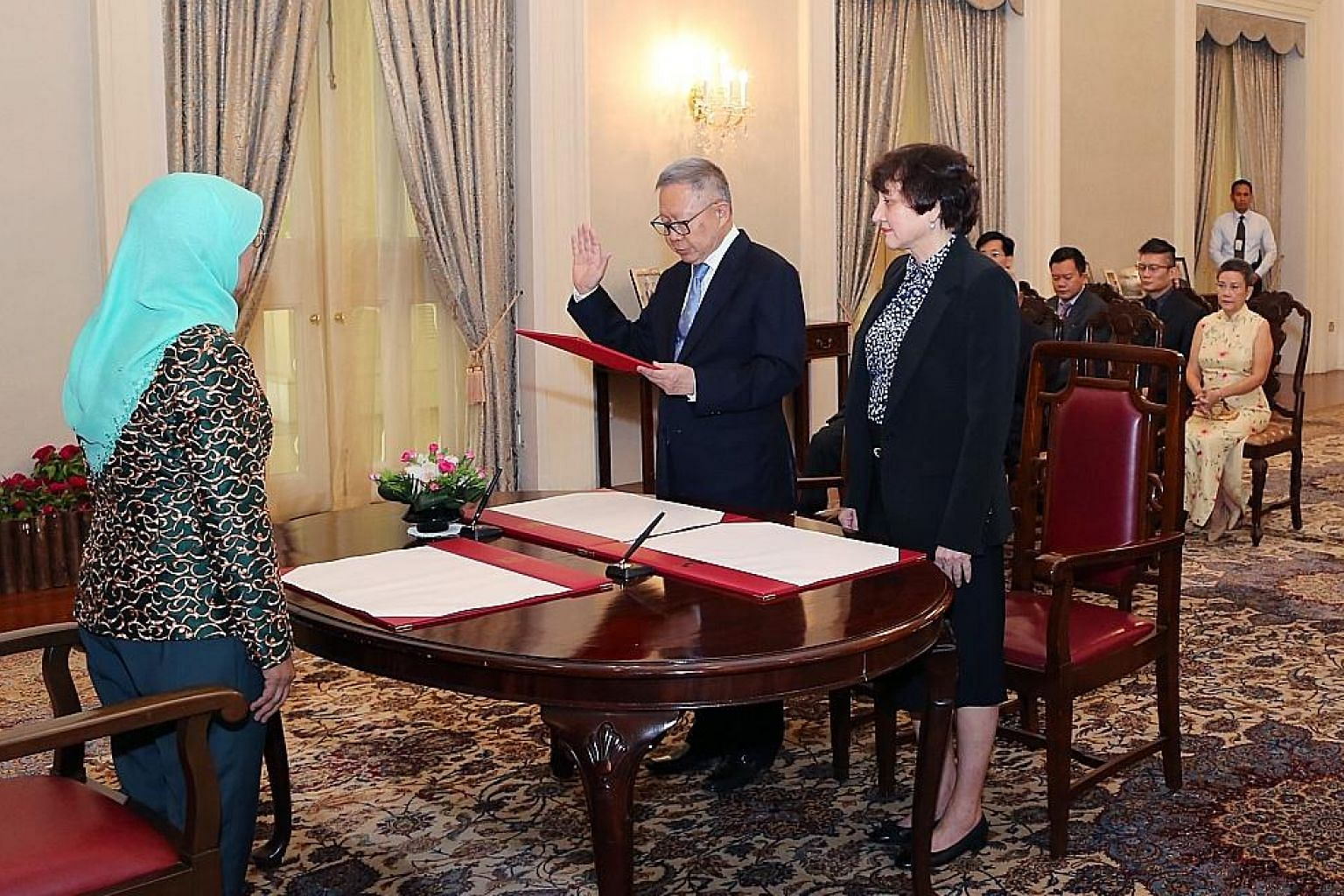 Mr Eddie Teo, seen here with President Halimah Yacob and Justice Judith Prakash, being sworn in as a member of the Council of Presidential Advisers yesterday.