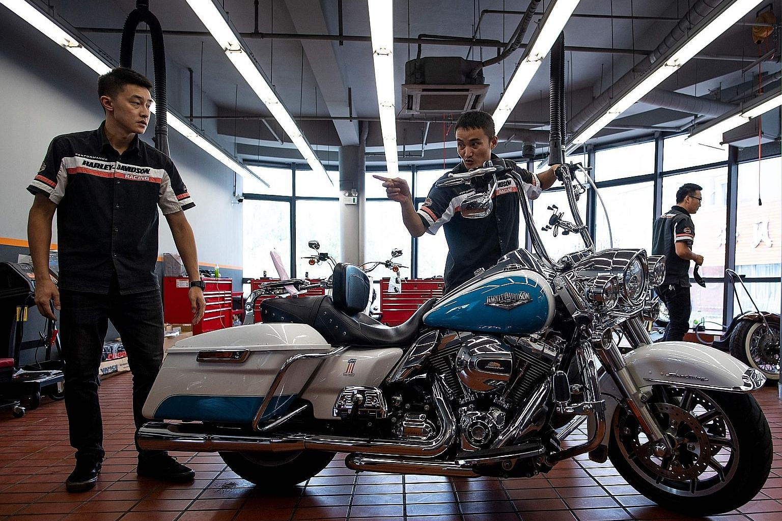 Workers preparing a Harley-Davidson motorcycle for sale at a dealership in Shanghai. From Harley-Davidson motorcycles and US bourbon to Chinese parts and machinery, the world's two largest economies have exchanged punitive tariffs across a wide swath