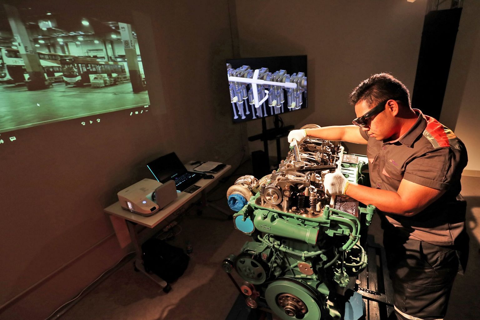 Technicians at the new Bus Technical Specialist Certification Centre, located at the Ulu Pandan Bus Depot, use augmented reality glasses as part of their training.