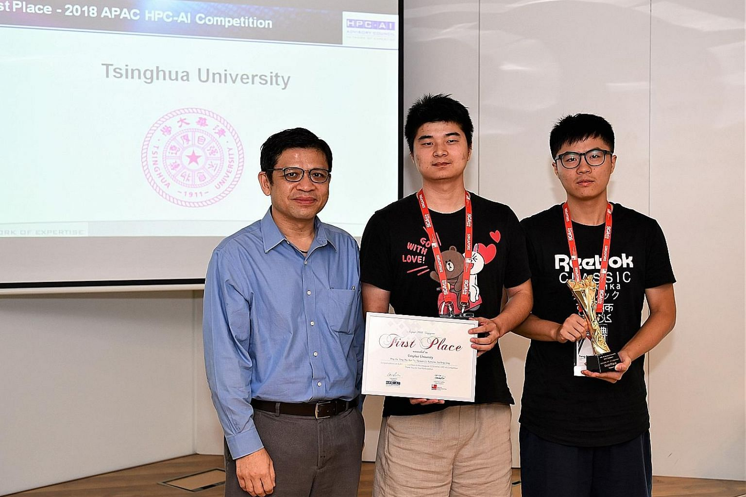 National Research Foundation president George Loh with master's students Xu Ping (centre), 23, and Ma Teng, 24, who were part of the Tsinghua University team that won the competition.