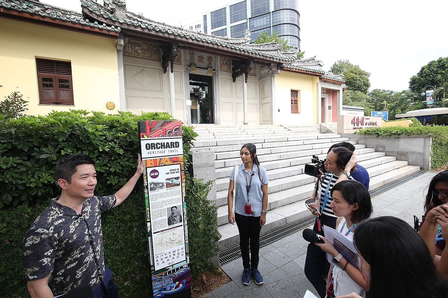 NHB's assistant chief executive (policy and community) Alvin Tan talking to the press outside the House of Tan Yeok Nee, which was completed in 1885. It is the last remaining Teochew mansion in Singapore.