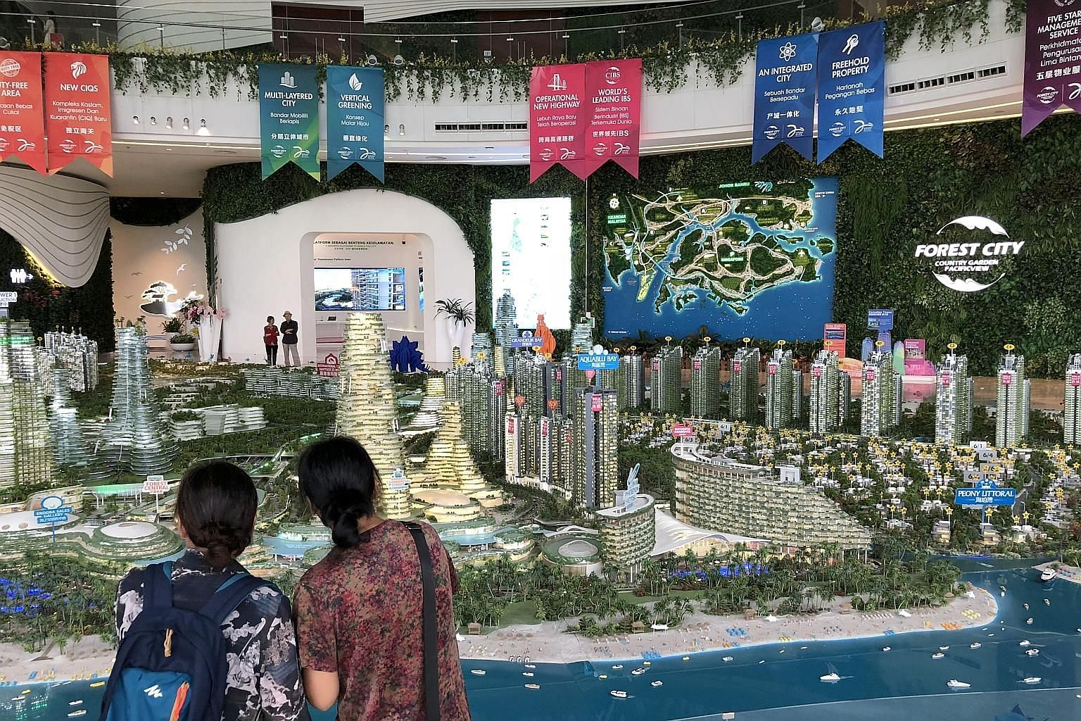 Visitors at the Forest City showroom in Johor Baru on Tuesday. Dr Mahathir Mohamad said on Monday that foreigners will be blocked from buying units in developer Country Garden's project and refused visas to live there.