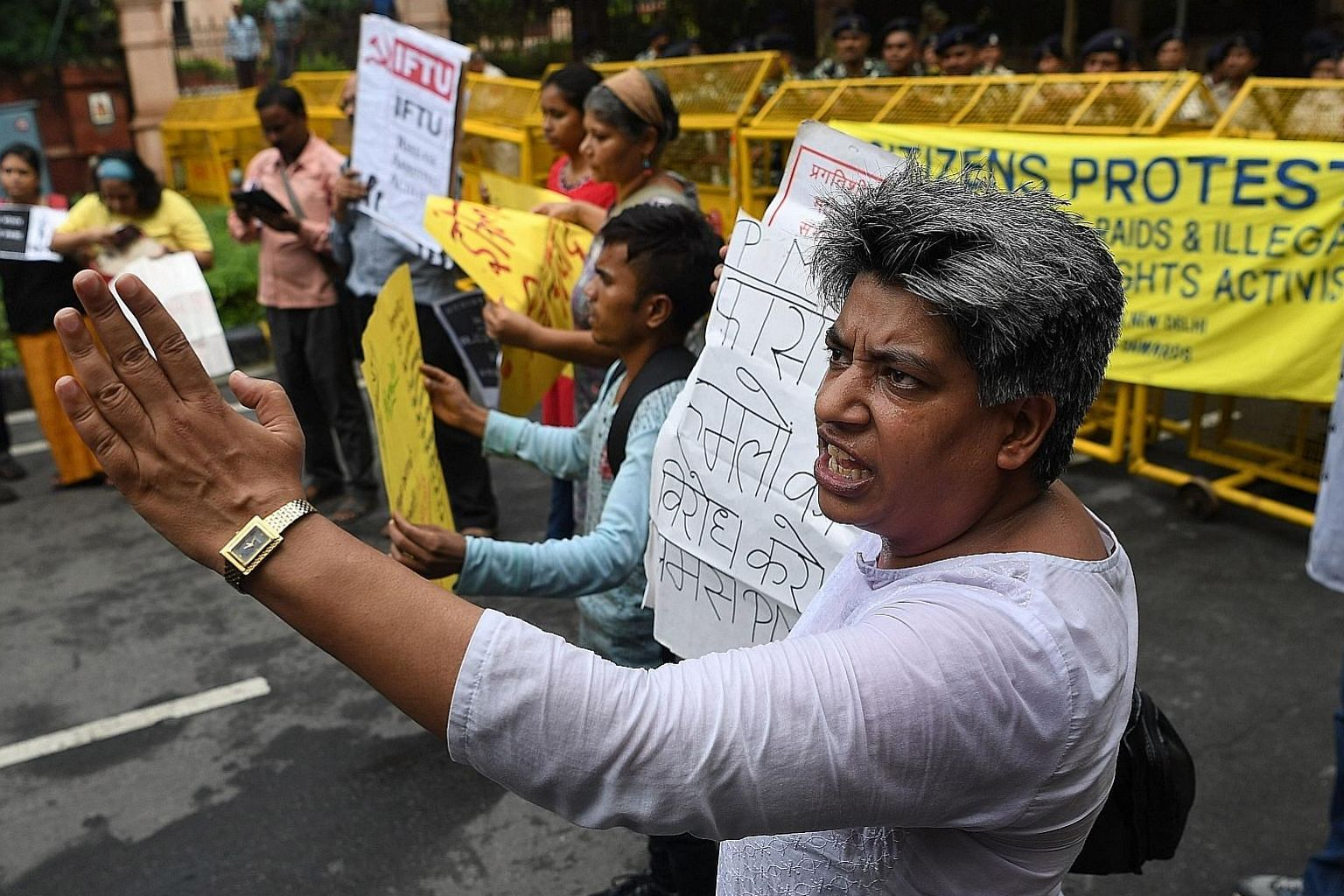 Dalit rights activists, intellectuals and journalists shouting slogans against the police raid and arrests of civil rights activists during a protest in New Delhi on Wednesday.