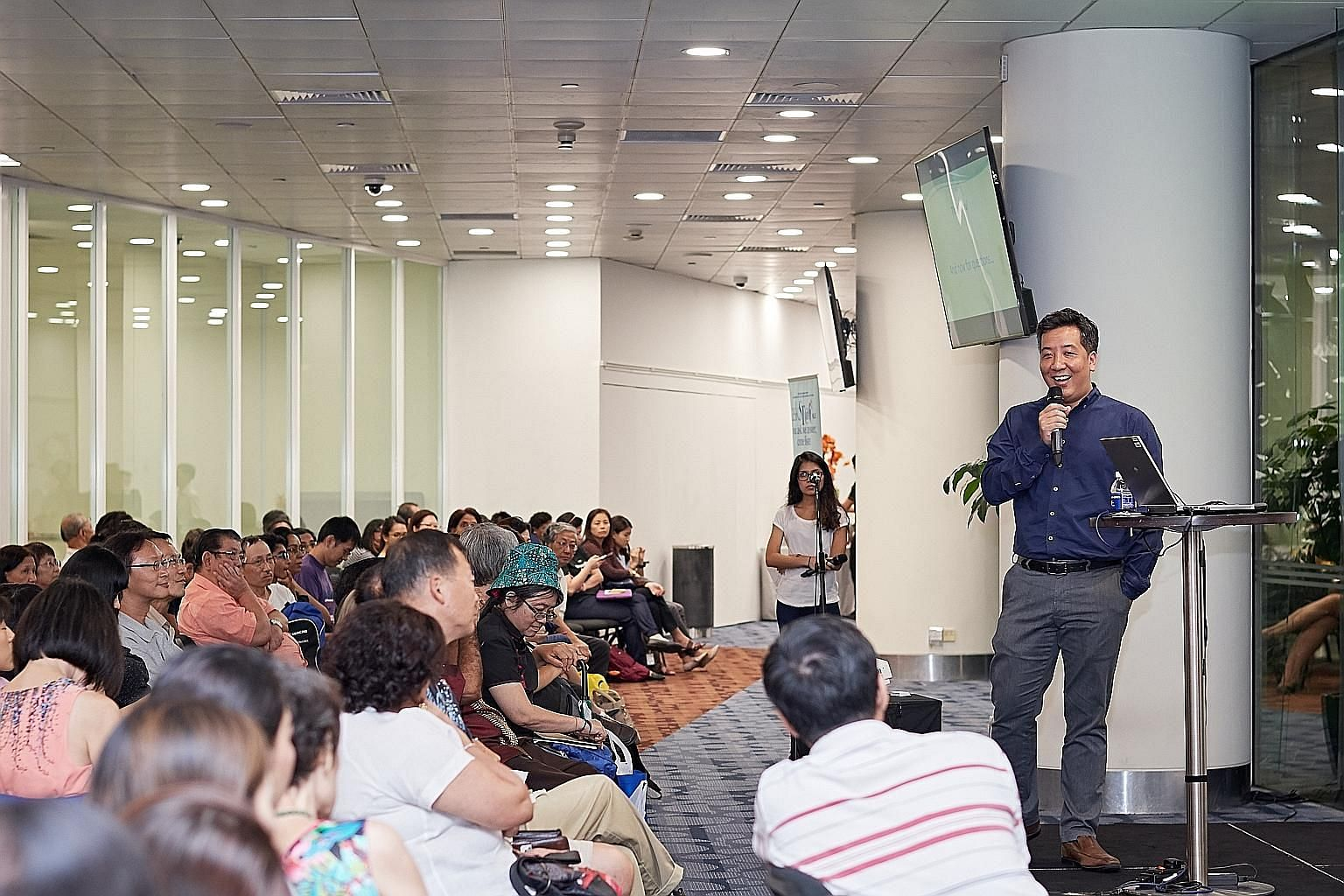 Straits Times news editor Marc Lim addressing some 200 people at the askST@NLB talk yesterday. He also tackled topics such as fake news and maintaining a newspaper's credibility.