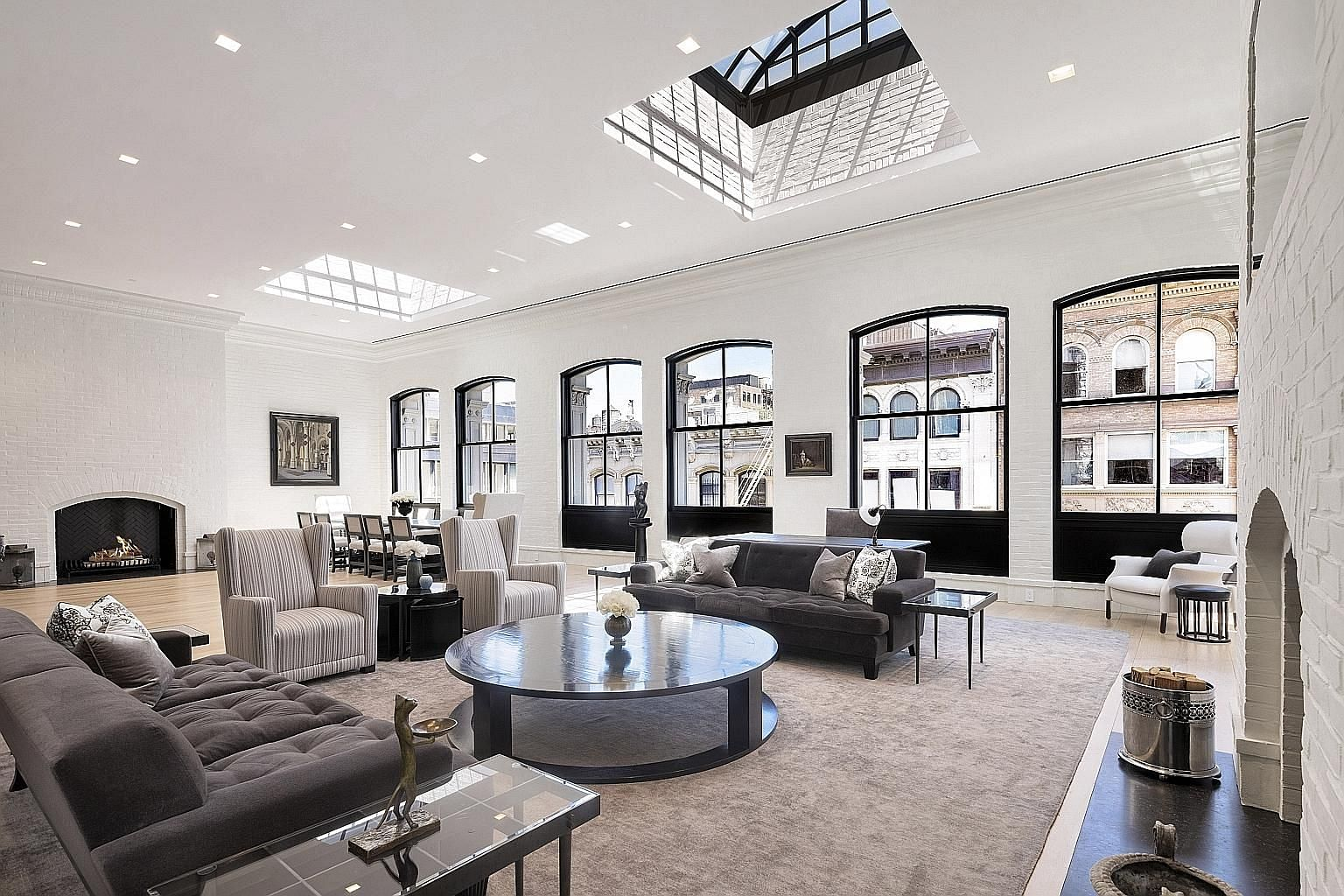 In a nod to the building's manufacturing past, industrial elements, such as steel in the skylights, have been incorporated into the penthouse over the years.