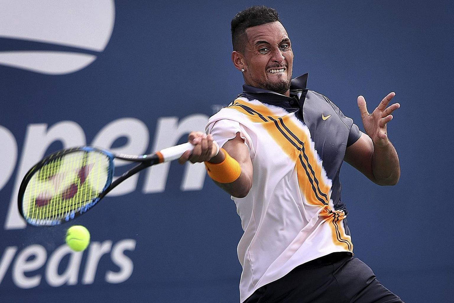 Australia's Nick Kyrgios in his US Open second-round match with France's Pierre-Hugues Herbert. Umpire Mohamed Lahyani stunned fans when he climbed down from his chair to give Kyrgios a controversial pep talk, which sparked a row over the impartialit