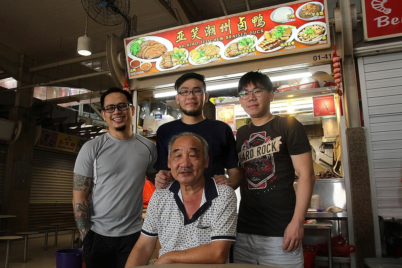 Braised duck stall owner Peh Thiam Teng, 65, who started his hawker business in 1987, is happy that his step-son, Mr Vince Chow, 38 (far left), and his two sons, Mr Kevan Peh (centre), 27, and Mr Peh Rui Hai, 30, are helping him full-time and plannin