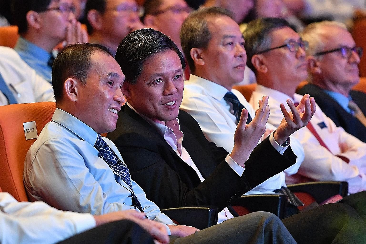 Minister Chan Chun Sing with A*Star chairman Lim Chuan Poh (far left) at the Leaders in Science Forum.