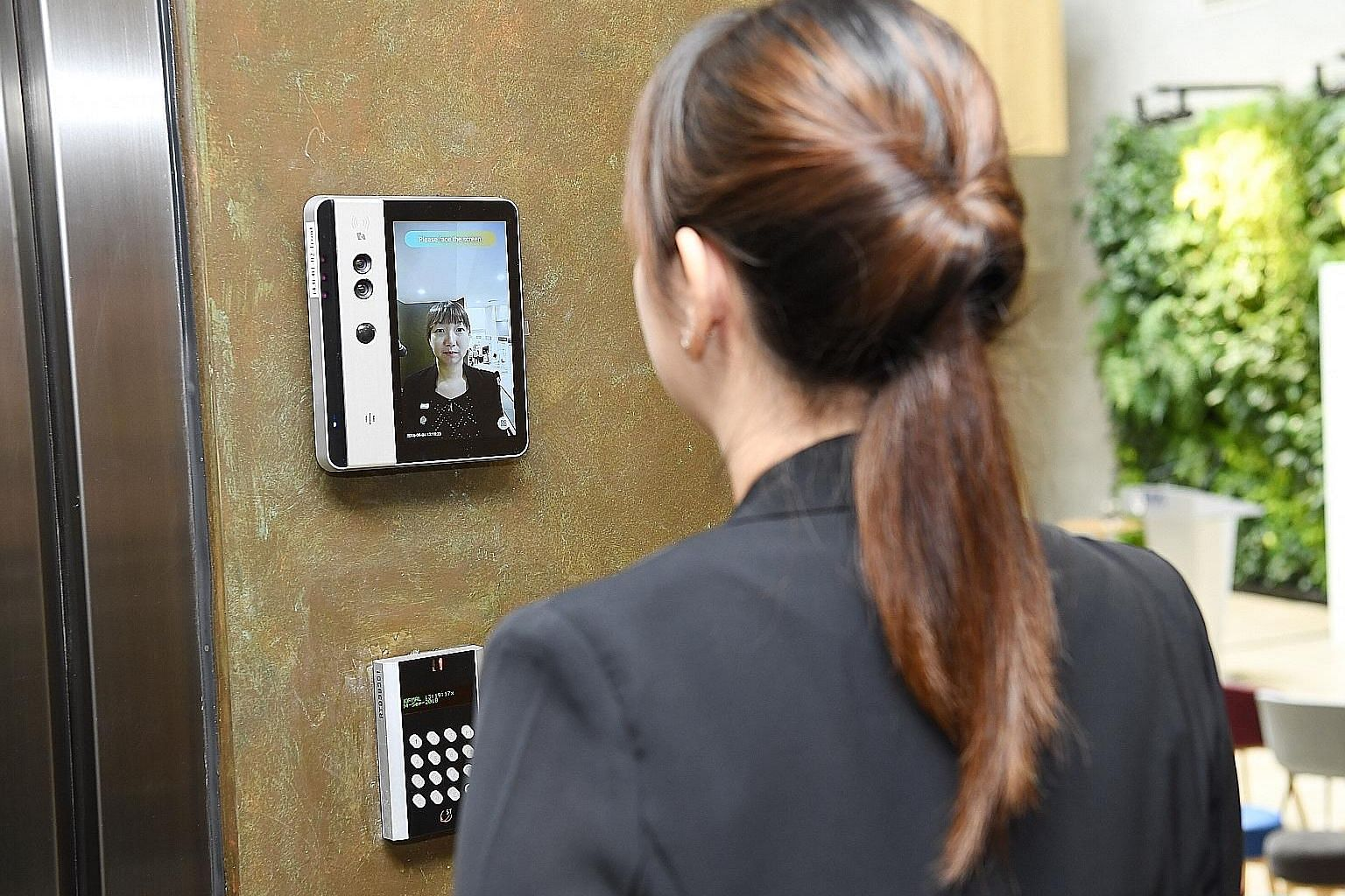 Right: The facial recognition door lock is used for entry to the offices and labs at innovation4.0. Far right: At the smart cafe, robot baristas use facial recognition technology to serve regular customers coffee suited to their tastes.