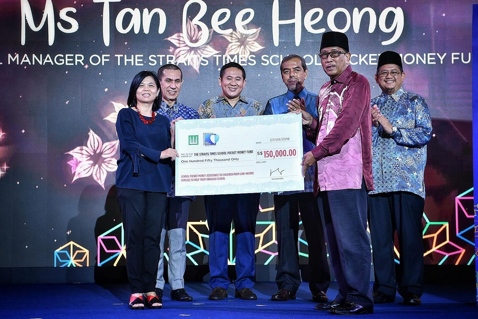 From left: Ms Tan Bee Heong, general manager of The Straits Times School Pocket Money Fund; Muis president Mohammad Alami Musa; Senior Parliamentary Secretary for Home Affairs and Health Amrin Amin; Muis chief executive Abdul Razak Hassan Maricar; Mr