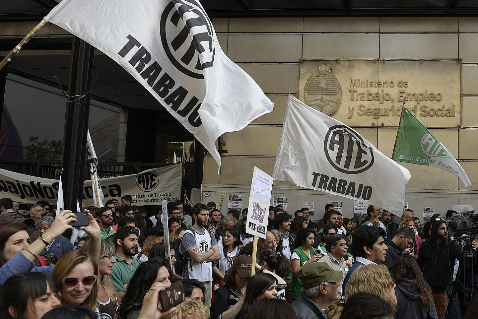 Public-sector employees in Argentina protesting last Friday in Buenos Aires against the government of President Mauricio Macri over sweeping new austerity measures. The economy is forecast to shrink by at least 1 per cent this year, and inflation has