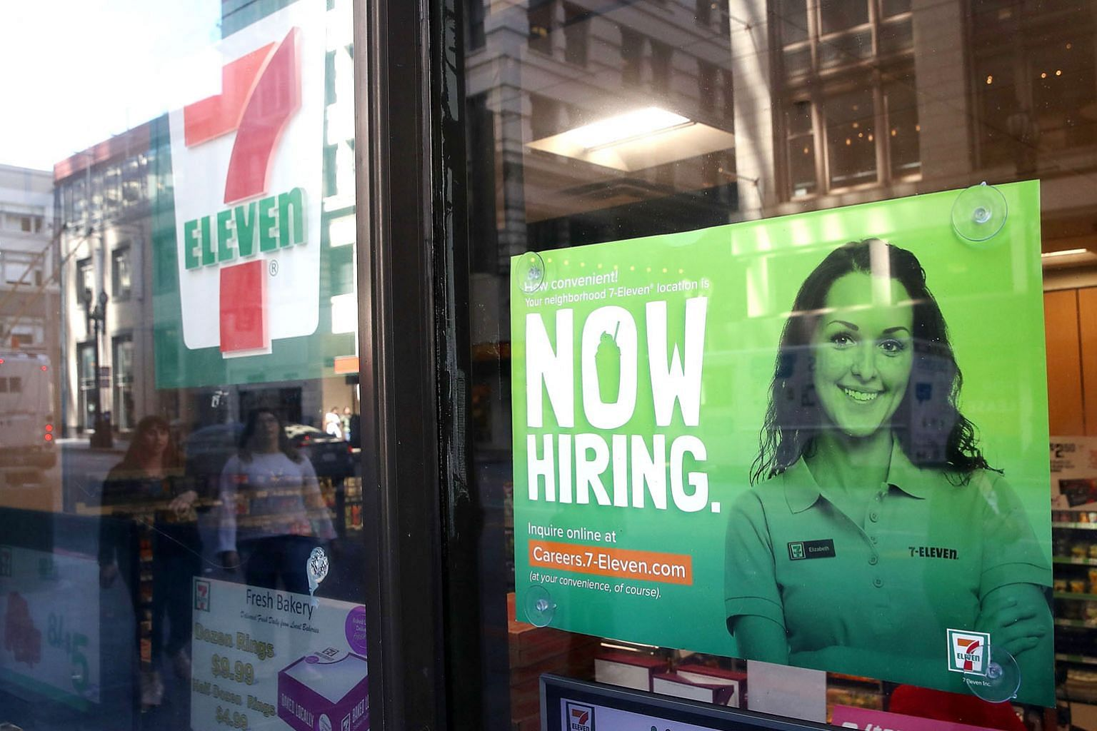 A hiring sign outside a 7-Eleven store in San Francisco. There are many low-wage earners in the United States who would love to have a real career and be able to support a family. But life gets in the way: training can cost tens of thousands of dolla