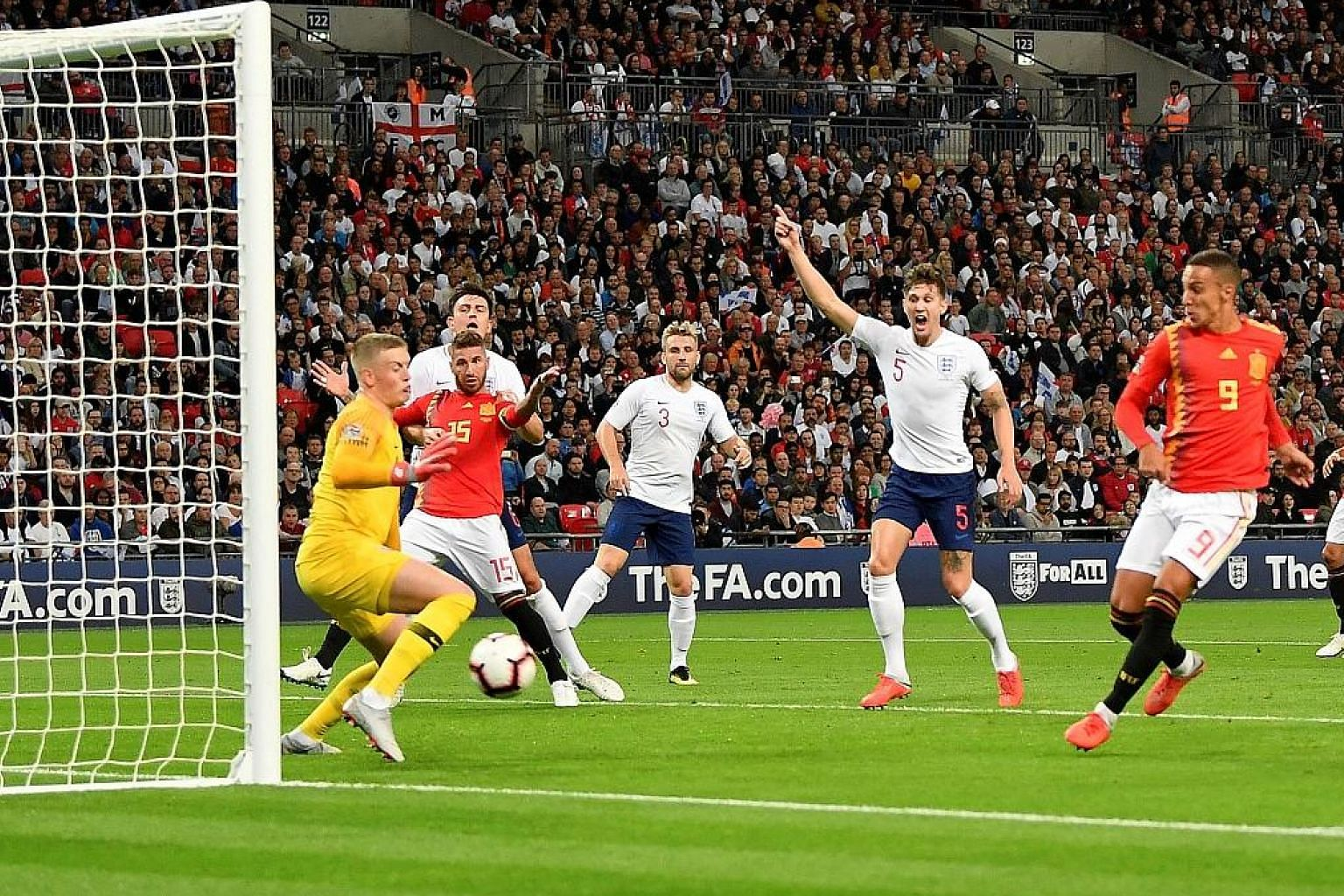 Rodrigo (No. 9) scoring Spain's second goal against England, who had Danny Welbeck's late strike ruled out by referee Danny Makkelie.