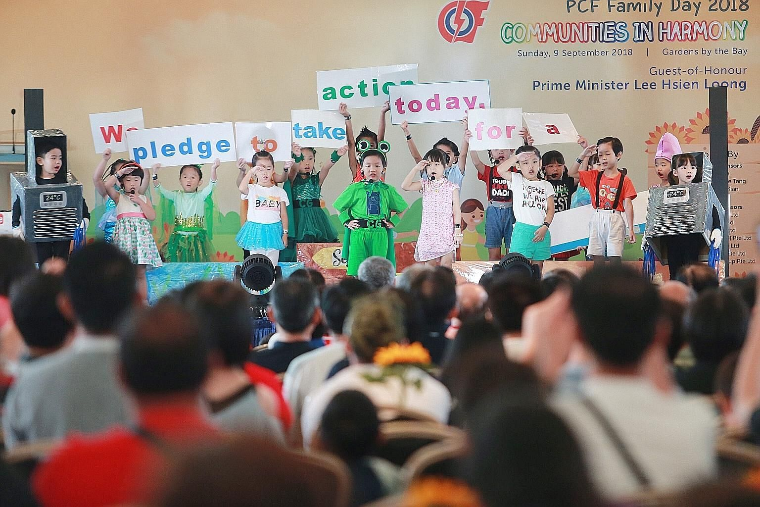 Children performing at the PAP Community Foundation (PCF) Family Day yesterday. Prime Minister Lee Hsien Loong said that providing affordable and high-quality pre-school education is an important way that the Government and the PCF are helping young
