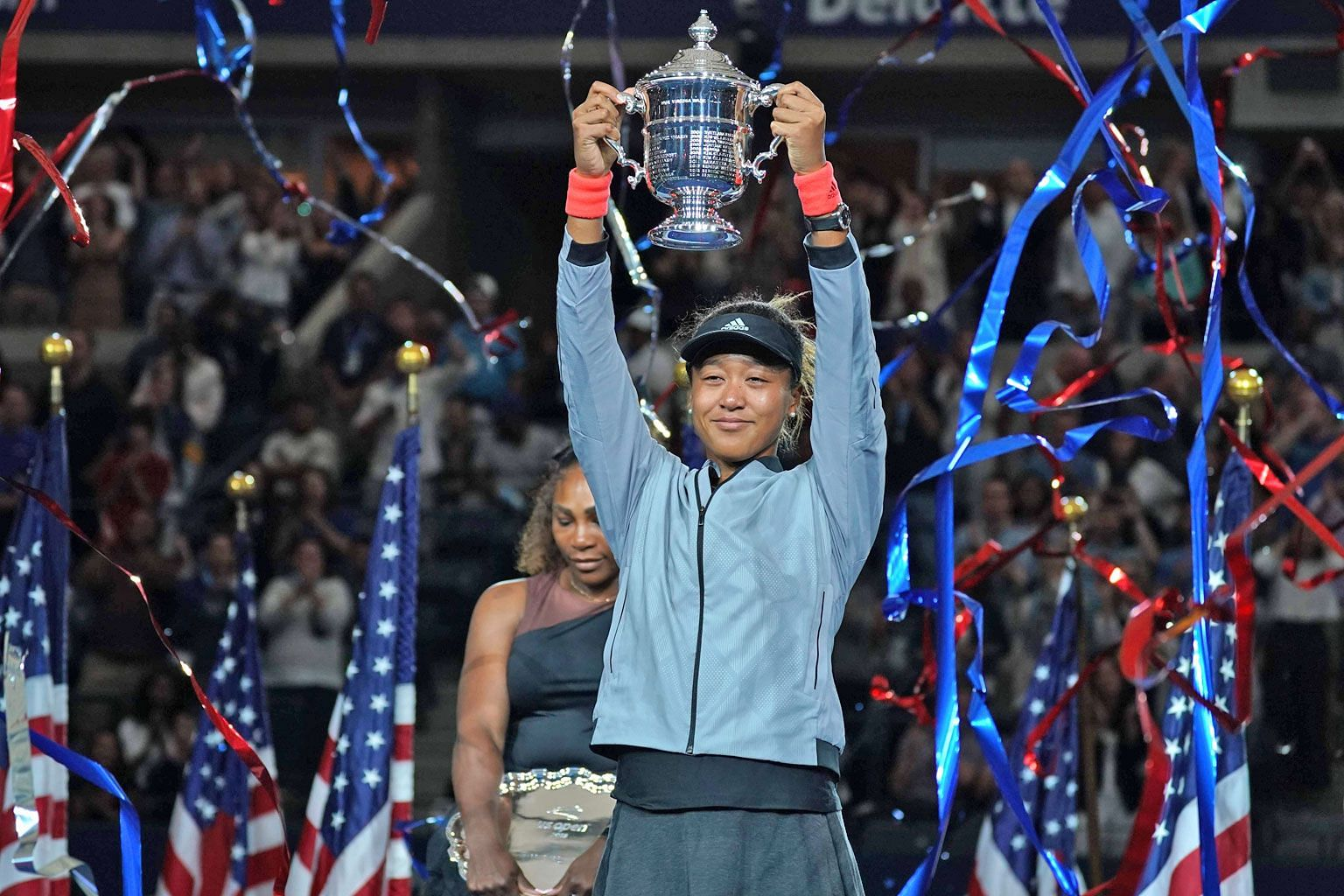 Naomi Osaka hoisting the US Open trophy after beating former world No. 1 Serena Williams in Saturday's final. She is only the second Asian woman to win a Grand Slam singles title.