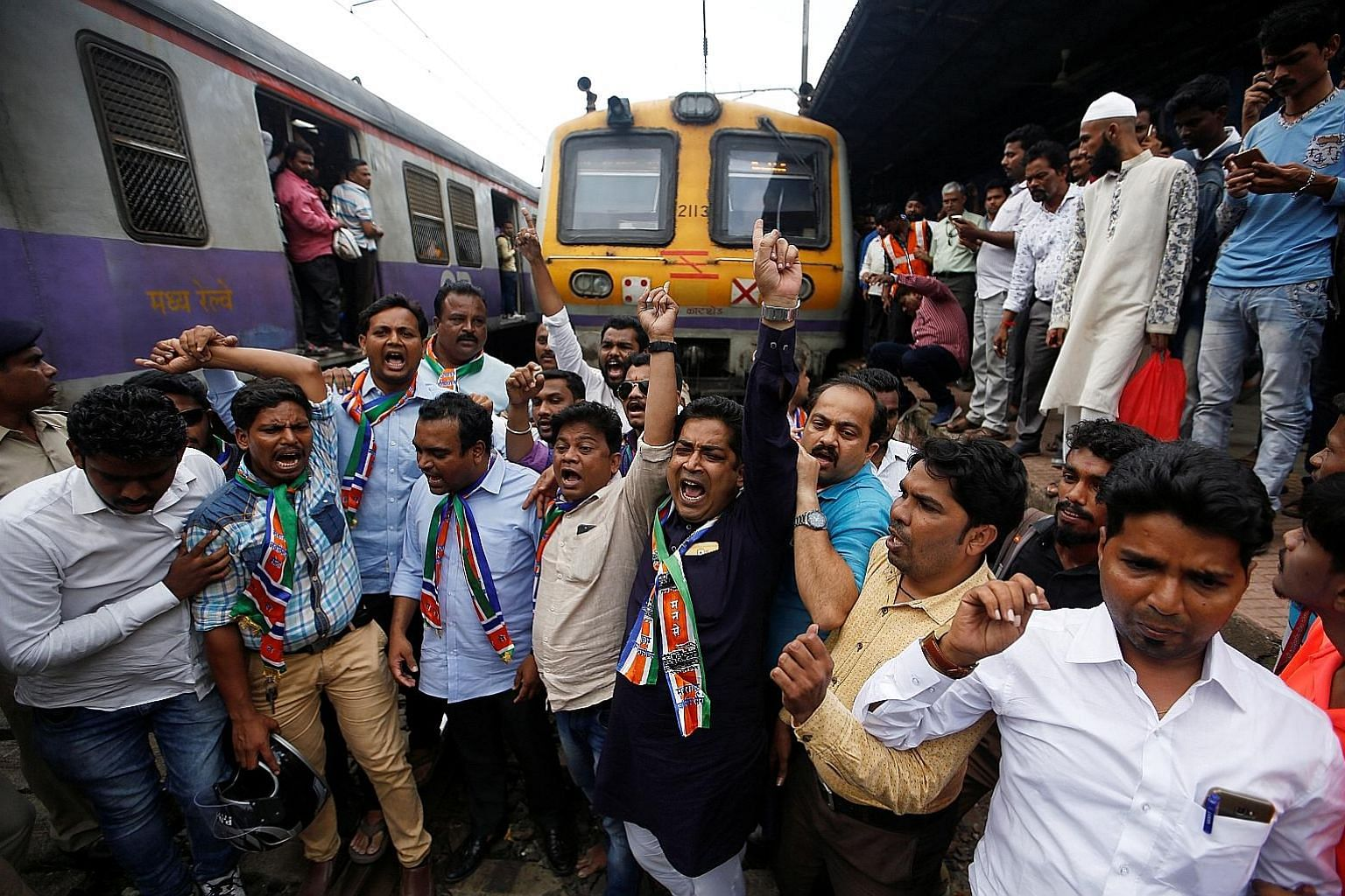 Supporters of the Maharashtra Navnirman Sena party blocking a railway track to protest against record high petrol and diesel prices in Mumbai.