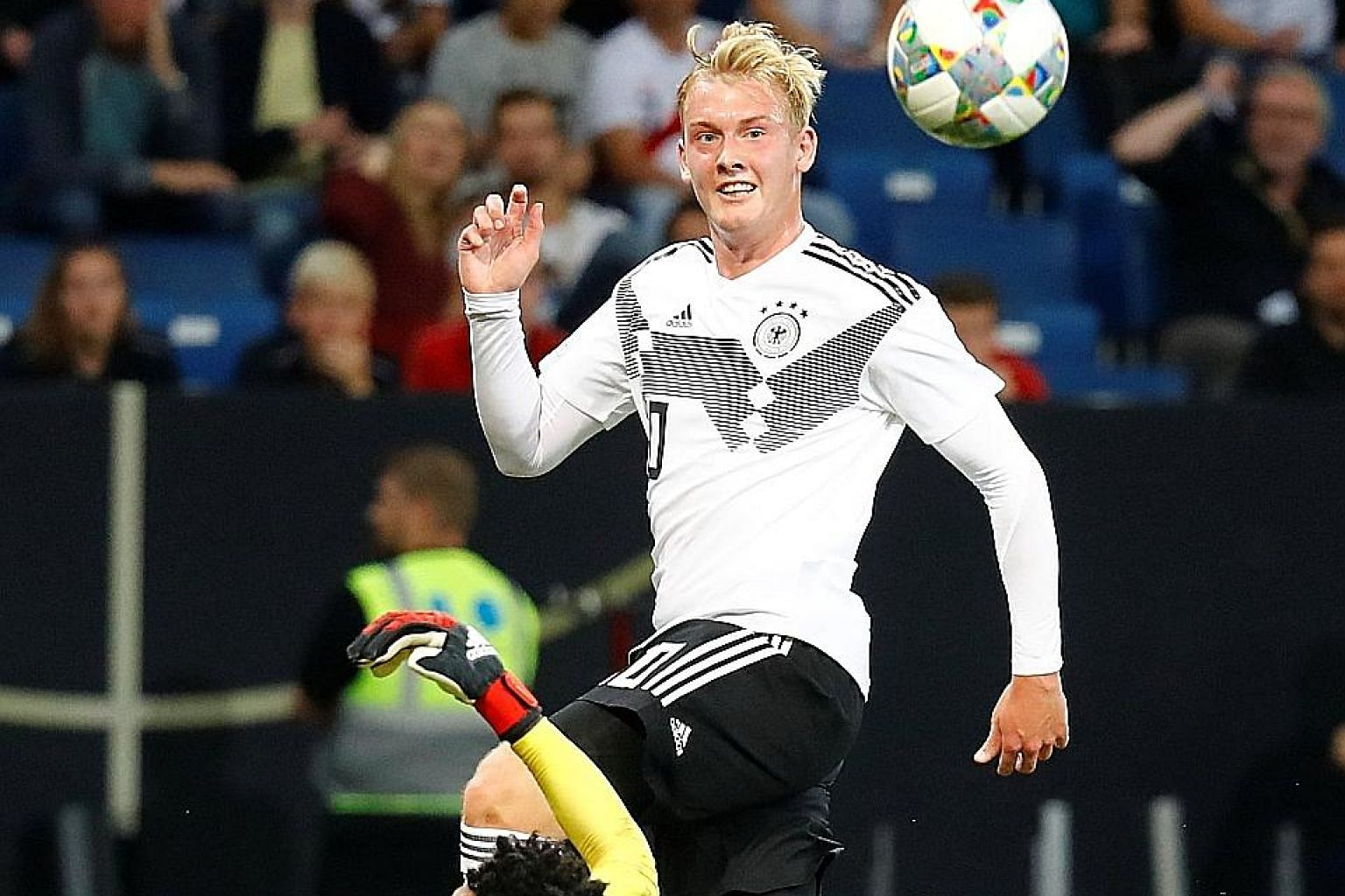 Germany's Julian Brandt lifting the ball over Peruvian goalkeeper Pedro Gallese to score their first goal during their international friendly. The Germans won 2-1 as they continued their rehabilitation following their group-stage exit at the World Cu
