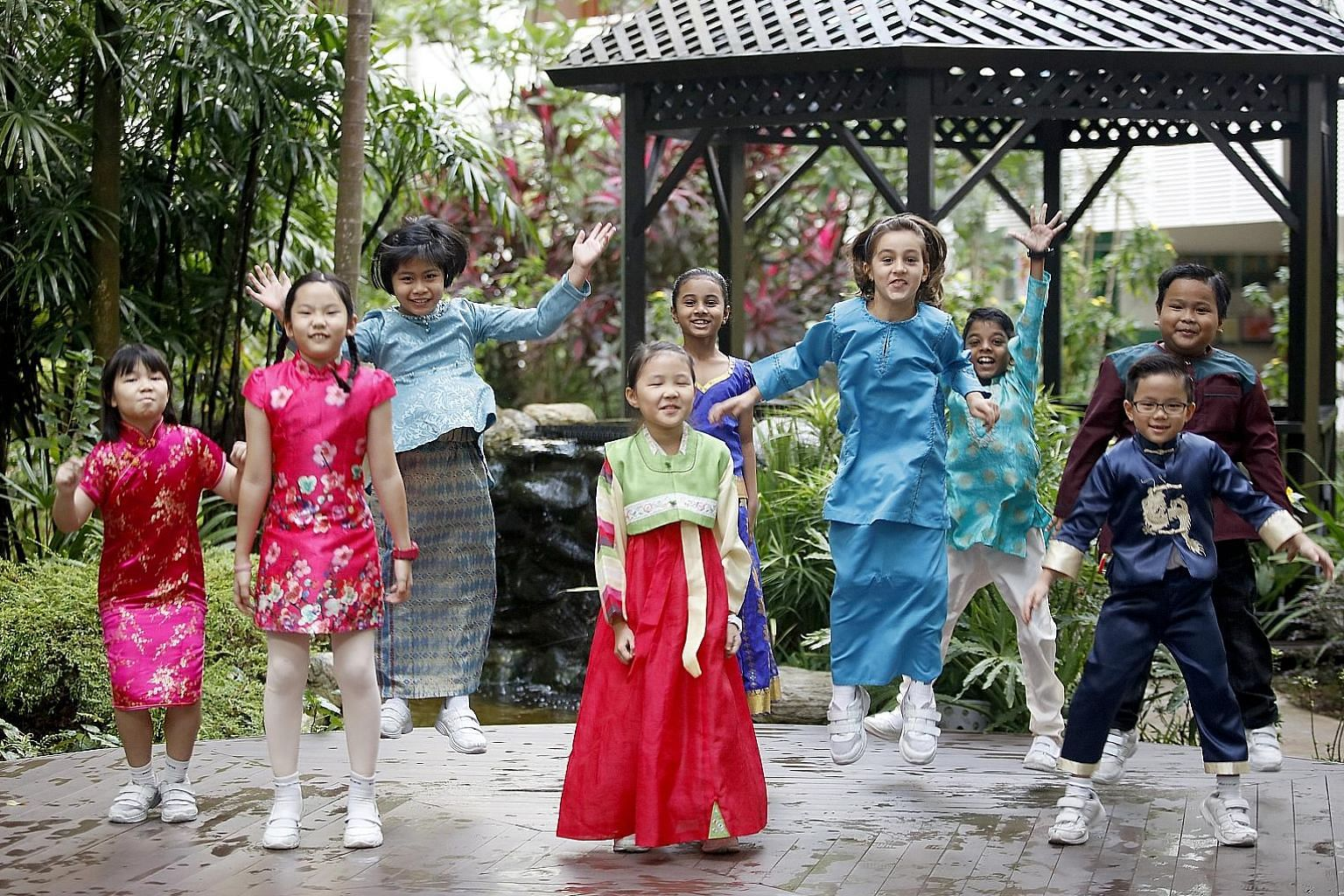 New Town Primary School pupils celebrating Racial Harmony Day. The writer's research suggests that everything else being equal, the racial integration within Singapore likely made Singaporeans more prosocial and helpful.