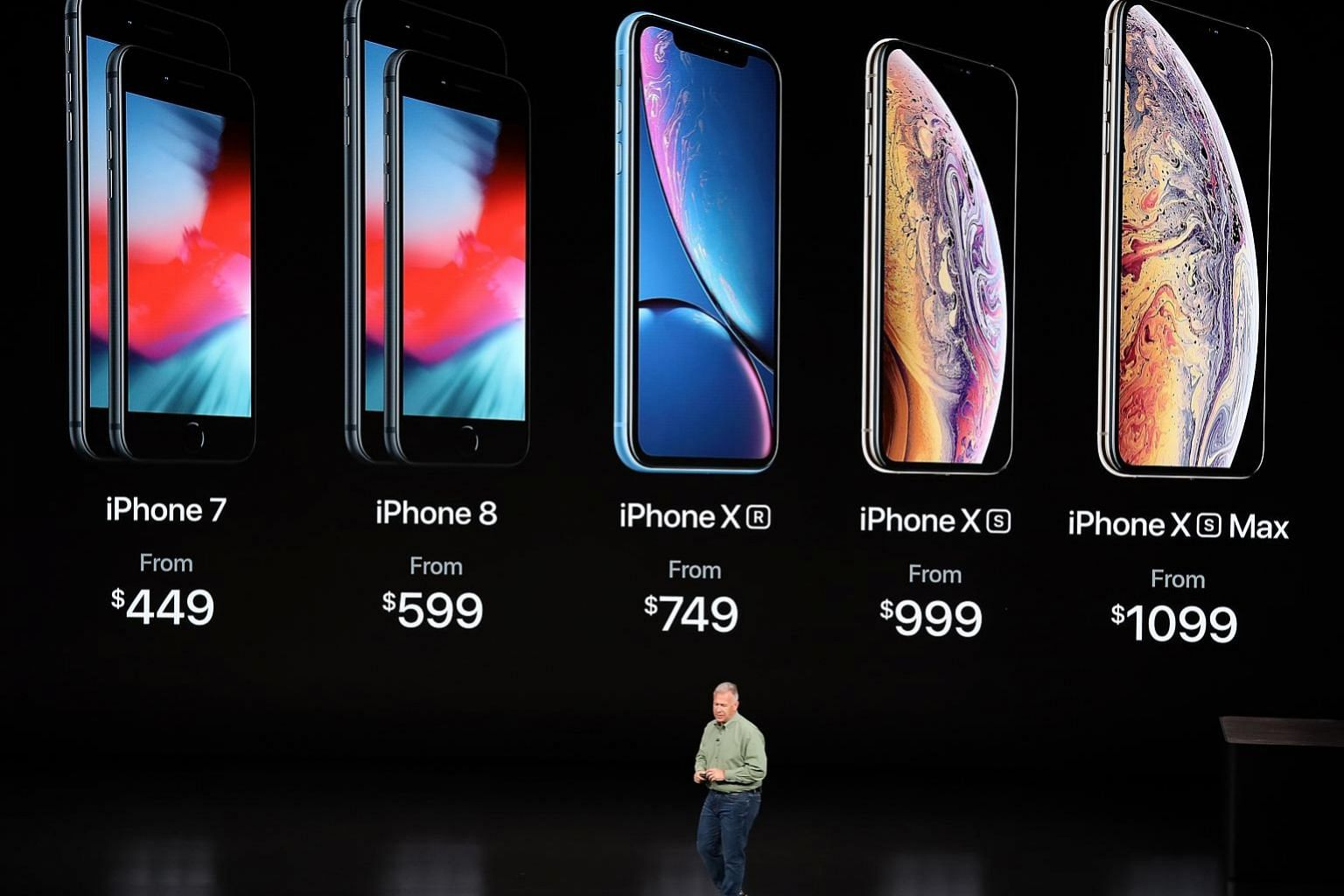 Apple's marketing head Phil Schiller introducing the new iPhone line-up during an event at the Steve Jobs Theatre in Apple Park, California, on Wednesday. All the new iPhones have a front-facing TrueDepth camera system for Face ID, or face recognitio