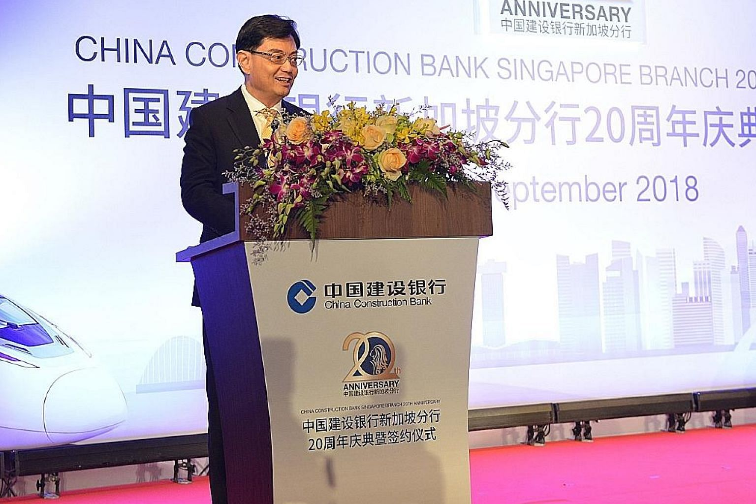 Finance Minister Heng Swee Keat speaking at China Construction Bank Singapore's 20th anniversary event yesterday.