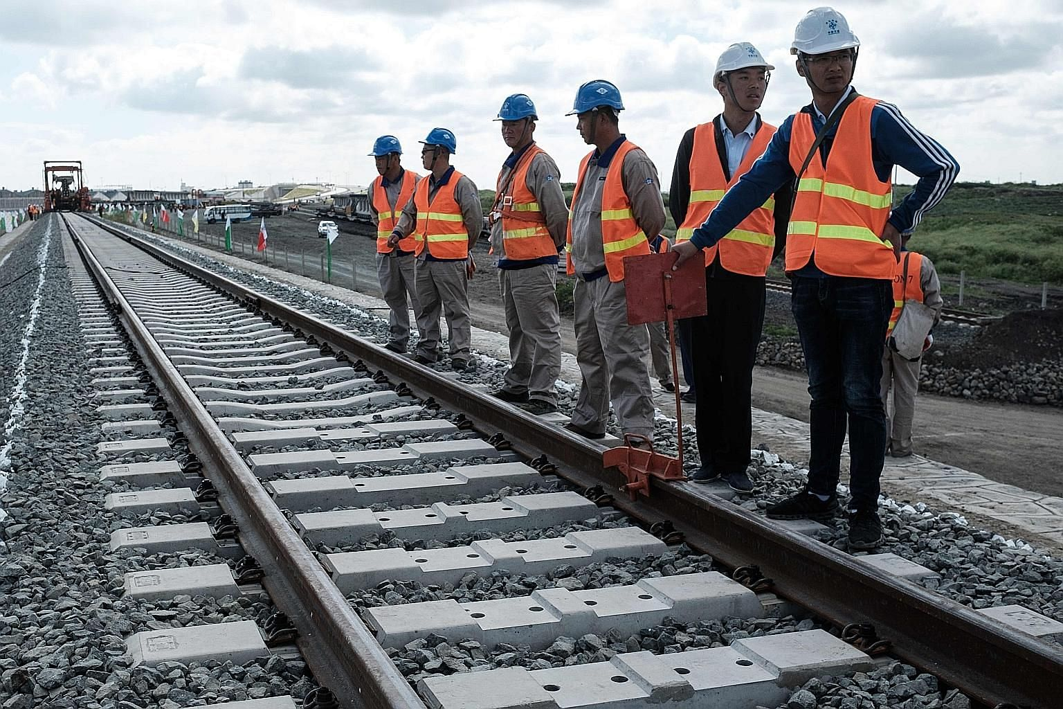 Chinese workers involved in a railway project in Kenya's Nairobi. China, unlike the former Soviet Union, extends its influence by trade or by building infrastructure in poorer countries.