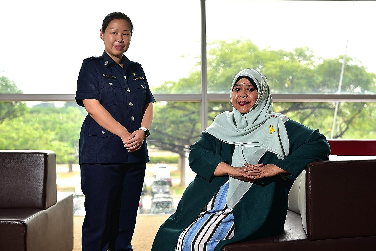Superintendent Valerie Chiang, senior assistant director, community and family policy branch of the Singapore Prison Service's rehabilitation and reintegration division; with Ms Suzana Ahmad, Yellow Ribbon Champion, Tampines Changkat division, at yes