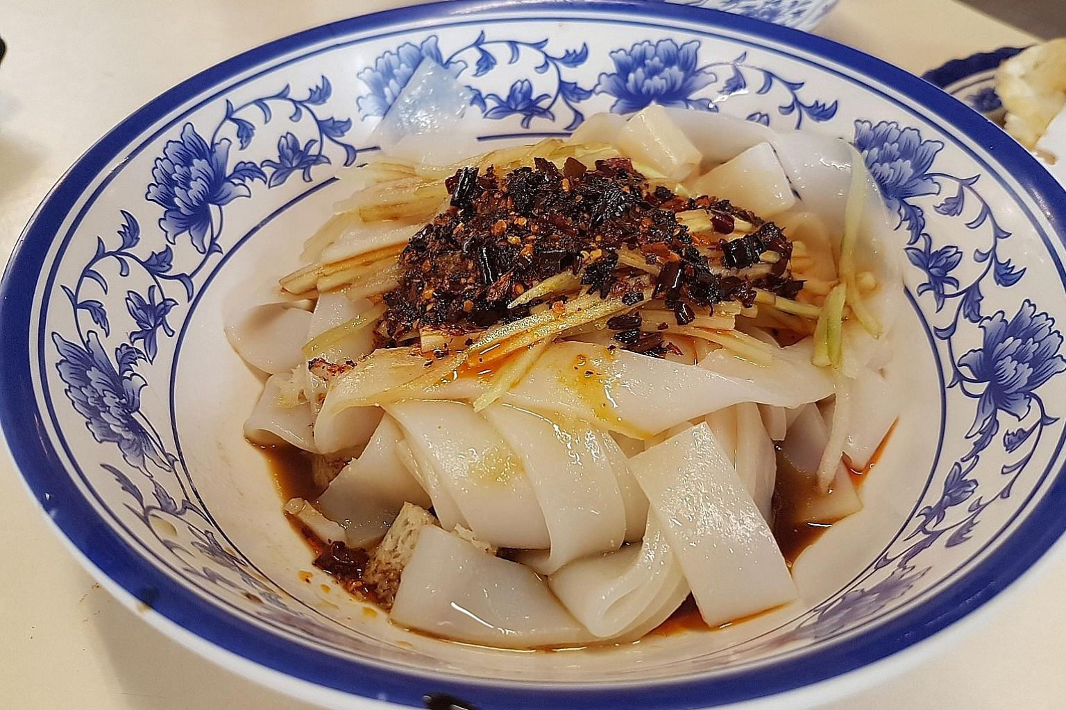 The Shaanxi cold noodlespack a bit of heat, but the coolness of the noodles also makes this a refreshing option in hot weather.