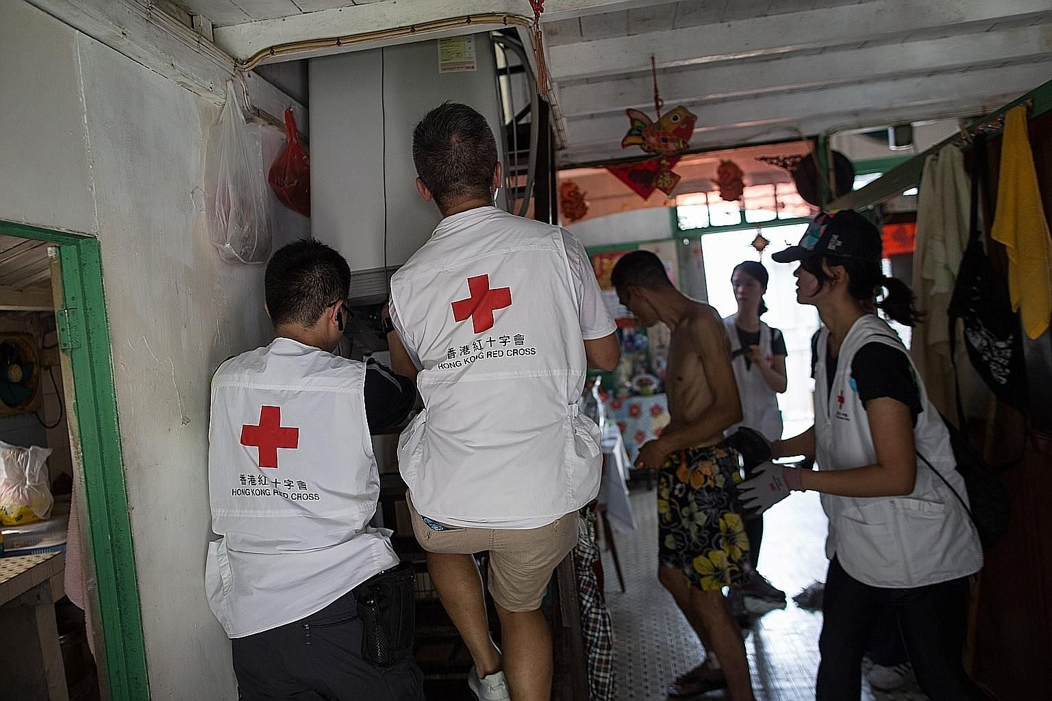 Volunteers helping residents to move their furniture to higher ground in Tai O village on Lantau Island, Hong Kong, yesterday. Evacuations have begun for some Tai O residents ahead of the arrival of super typhoon Mangkhut.