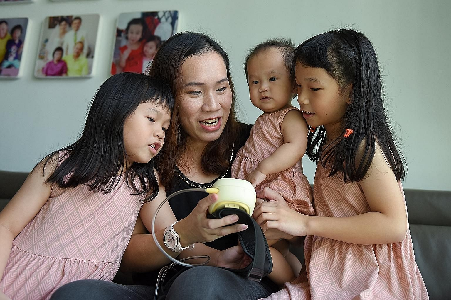 Property agent Corrine Lim has used her portable pump to express milk for her three children (from left) Alynna, five, Alydia, one, and Alyssa, seven. Mrs Felirose Bartolome with her husband and children, and the milk (above) she flies home to the Ph