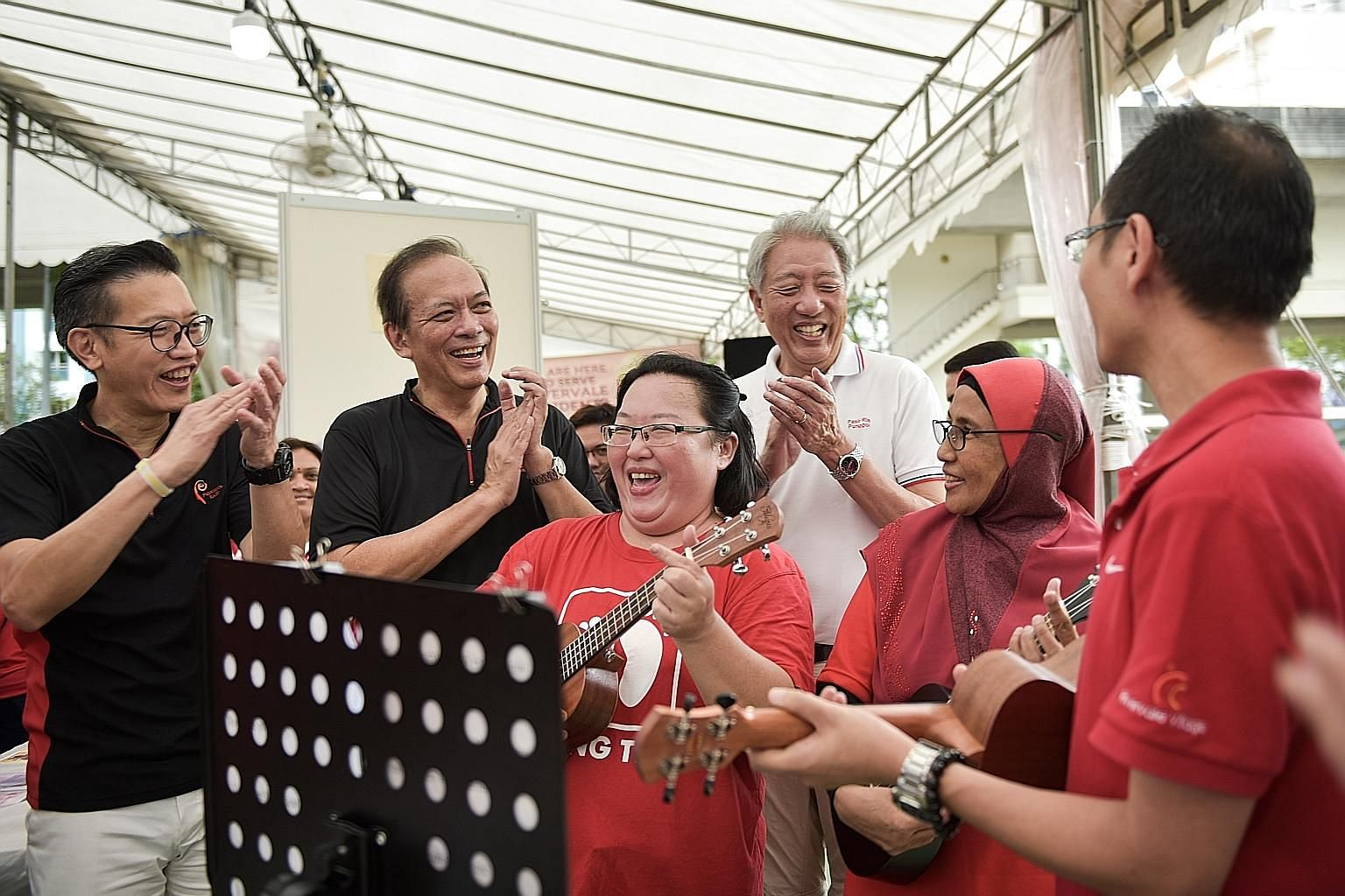 Punggol East MP Charles Chong (second from left) and Deputy Prime Minister Teo Chee Hean (in white) interacting with some of the residents of Punggol at yesterday's groundbreaking ceremony. The new community club will have a childcare centre, two dan