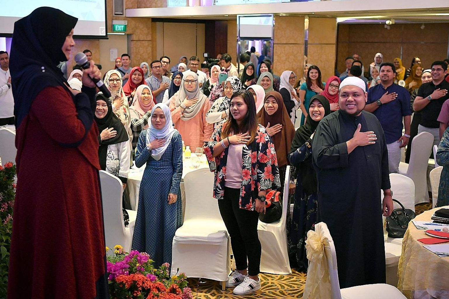 Motivational speaker Muhaya Mohamad (left) speaking at the parenting seminar organised by the Association of Muslim Professionals and the Centre for Fathering yesterday. The other speaker was Ustaz Zahid Zin (in white songkok), chief executive of Mus