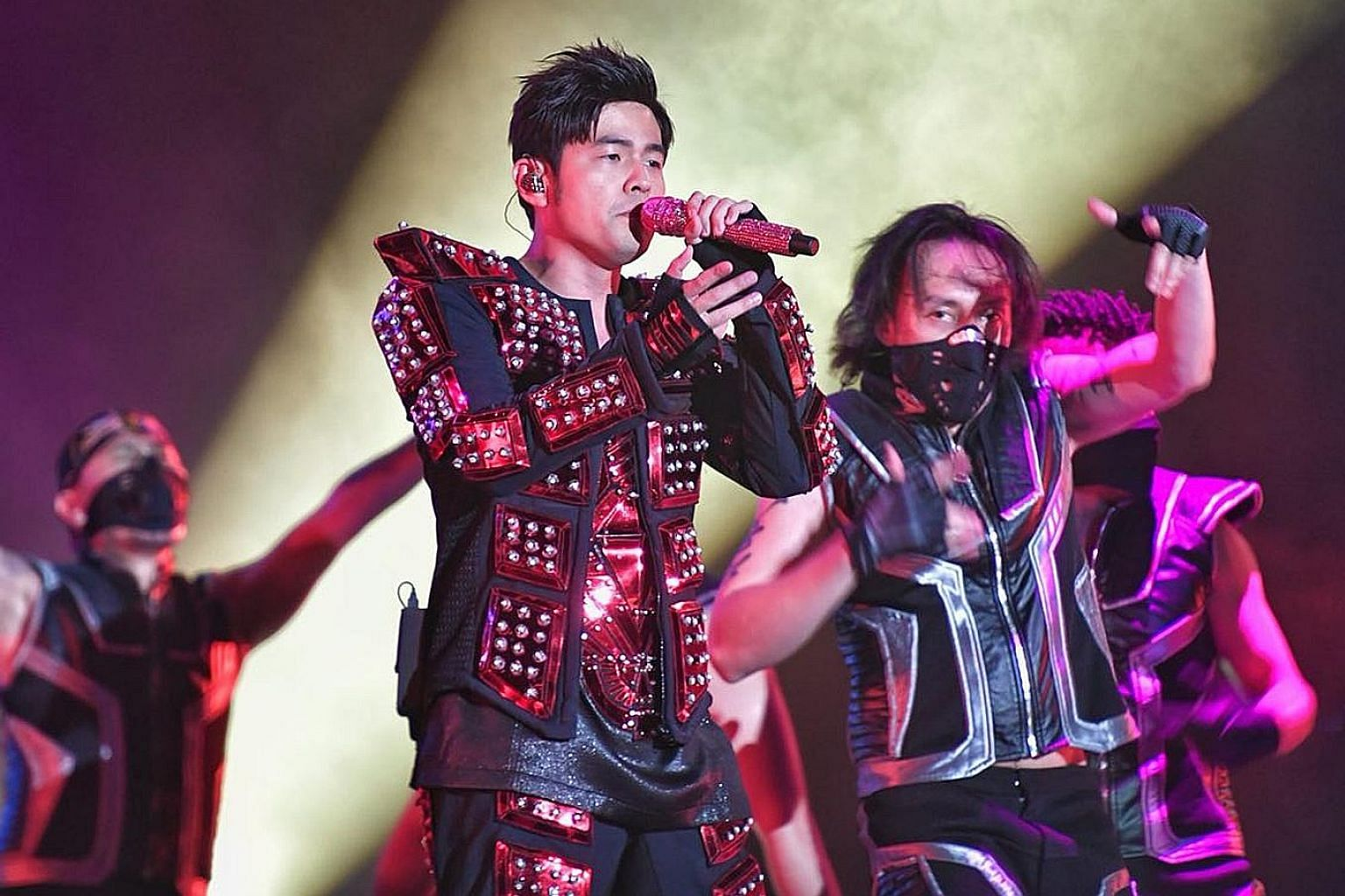 Embracing bright colours and shiny sequins, Taiwanese singer Jay Chou churned out his hits at his Formula One concert.
