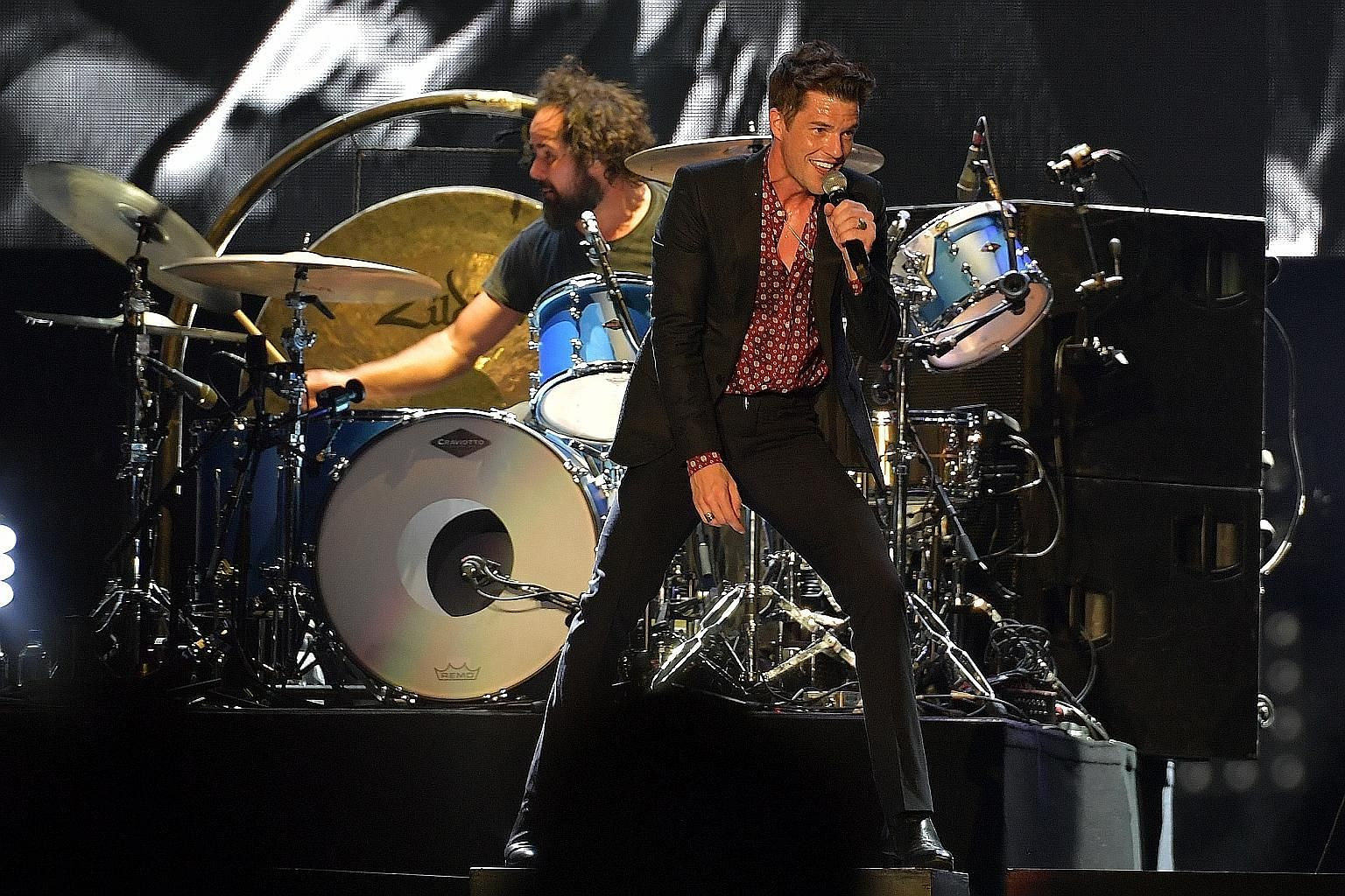 Brandon Flowers (above) of American band The Killers and British singer and ex-Oasis frontman Liam Gallagher (left) at their gigs over the weekend.