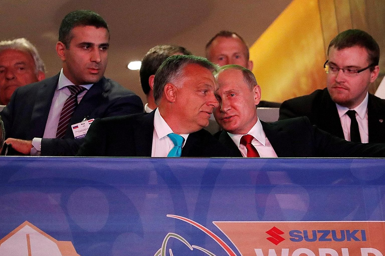 Russian President Vladimir Putin (right) talking to Hungarian Prime Minister Viktor Orban at a judo championship in Budapest last year. Mr Orban is an outspoken opponent of continued Western sanctions against Russia and has expressed open admiration