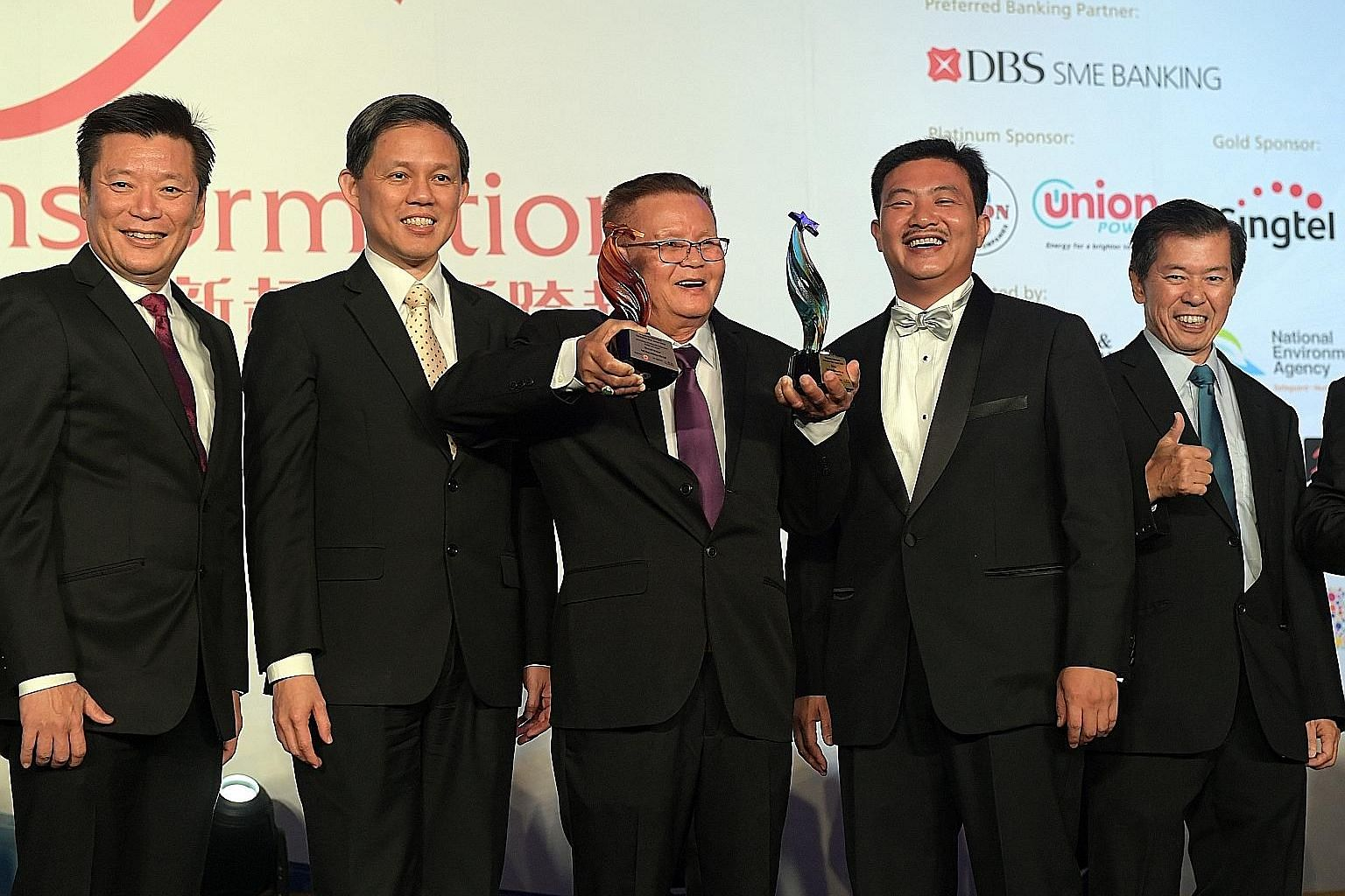 At last night's Singapore Heartland Enterprise Star Awards were (from left) Mr Goh Sin Teck, editor of Lianhe Zaobao and Lianhe Wanbao; Minister for Trade and Industry Chan Chun Sing; Poh Cheu Kitchen founder Neo Poh Cheu, the overall award winner in
