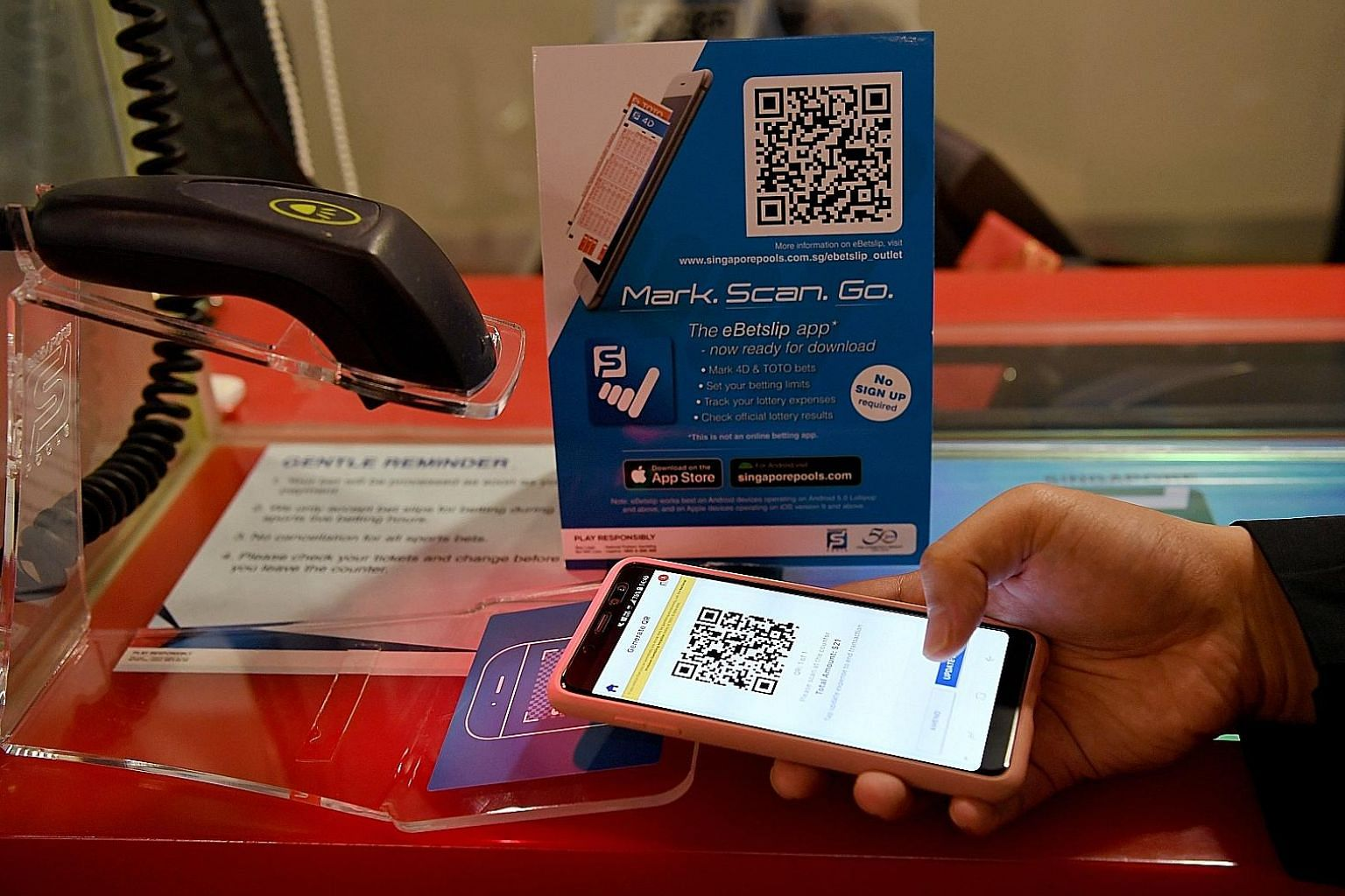 A unique QR code will be generated after an e-betting slip is marked out. Punters can scan the code at Singapore Pools outlets for a physical betting ticket after making payment. Scanning services for the QR codes are available at 25 Singapore Pools