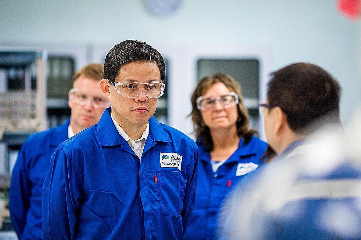 Minister for Trade and Industry Chan Chun Sing visiting the expanded facilities of US additives firm Afton Chemical yesterday. The $222 million expansion brings the company's total investment here to $380 million.
