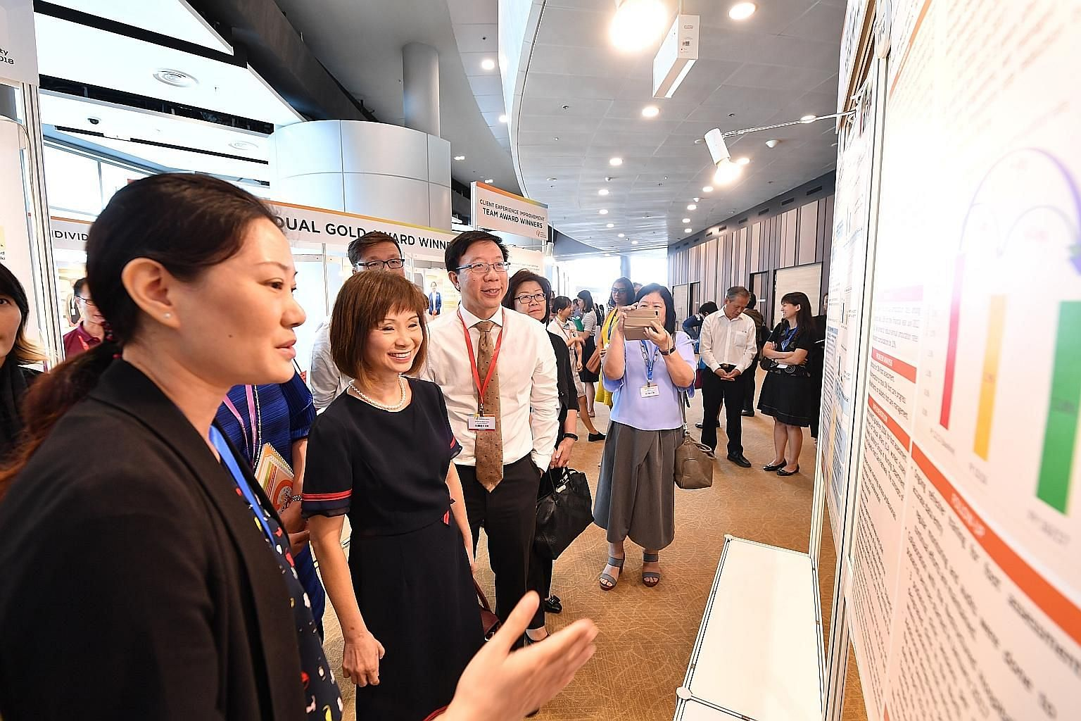 Senior Minister of State for Health Amy Khor viewing exhibits at the Quality and Productivity Festival organised by the Agency for Integrated Care yesterday. At the festival, the AIC presented awards to more than 400 individuals and teams for excelle