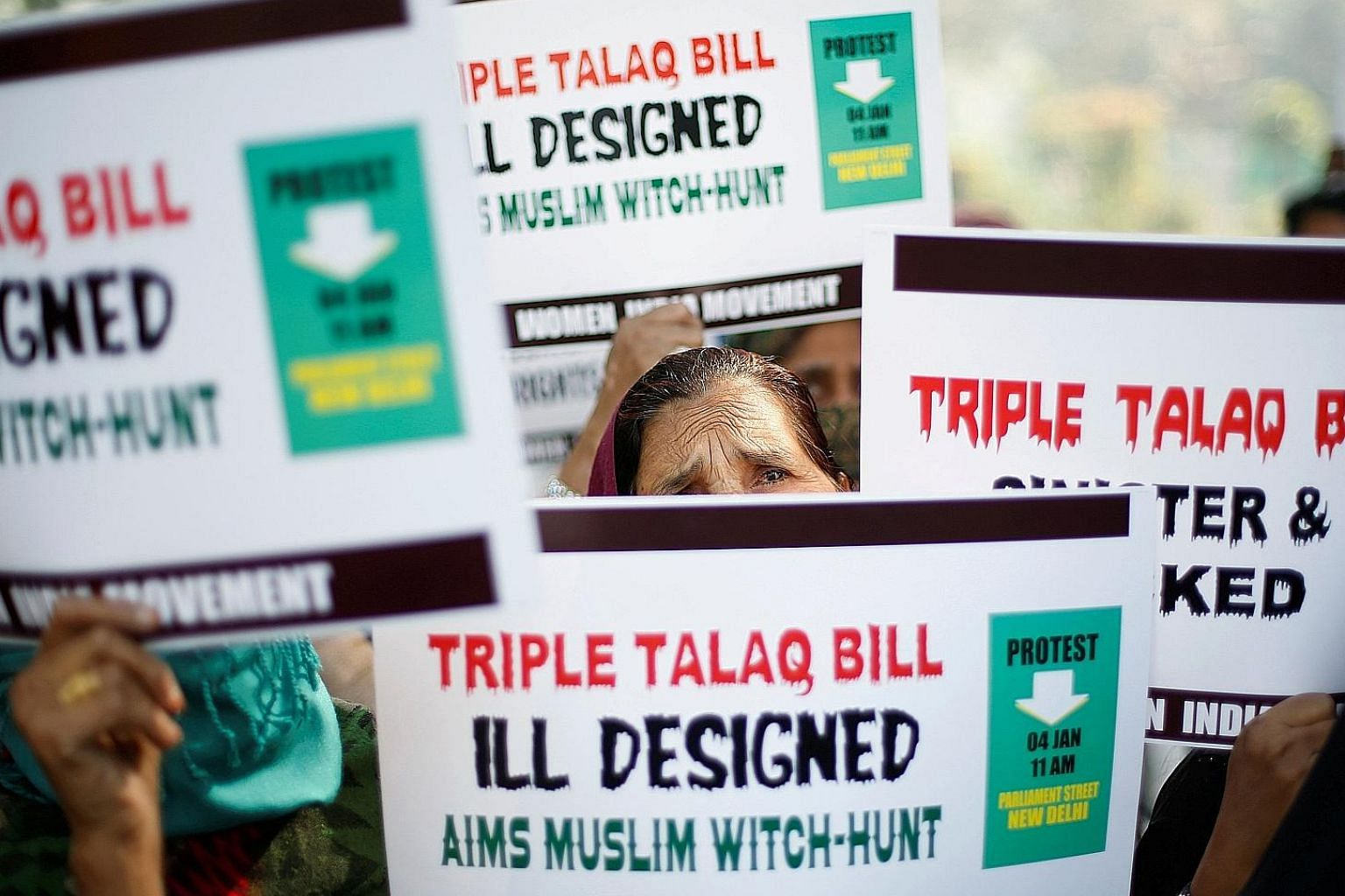 """Muslim women protesting in New Delhi on Jan 4 against a government move aimed at prosecuting Muslim men who divorce their wives through the """"triple talaq""""."""