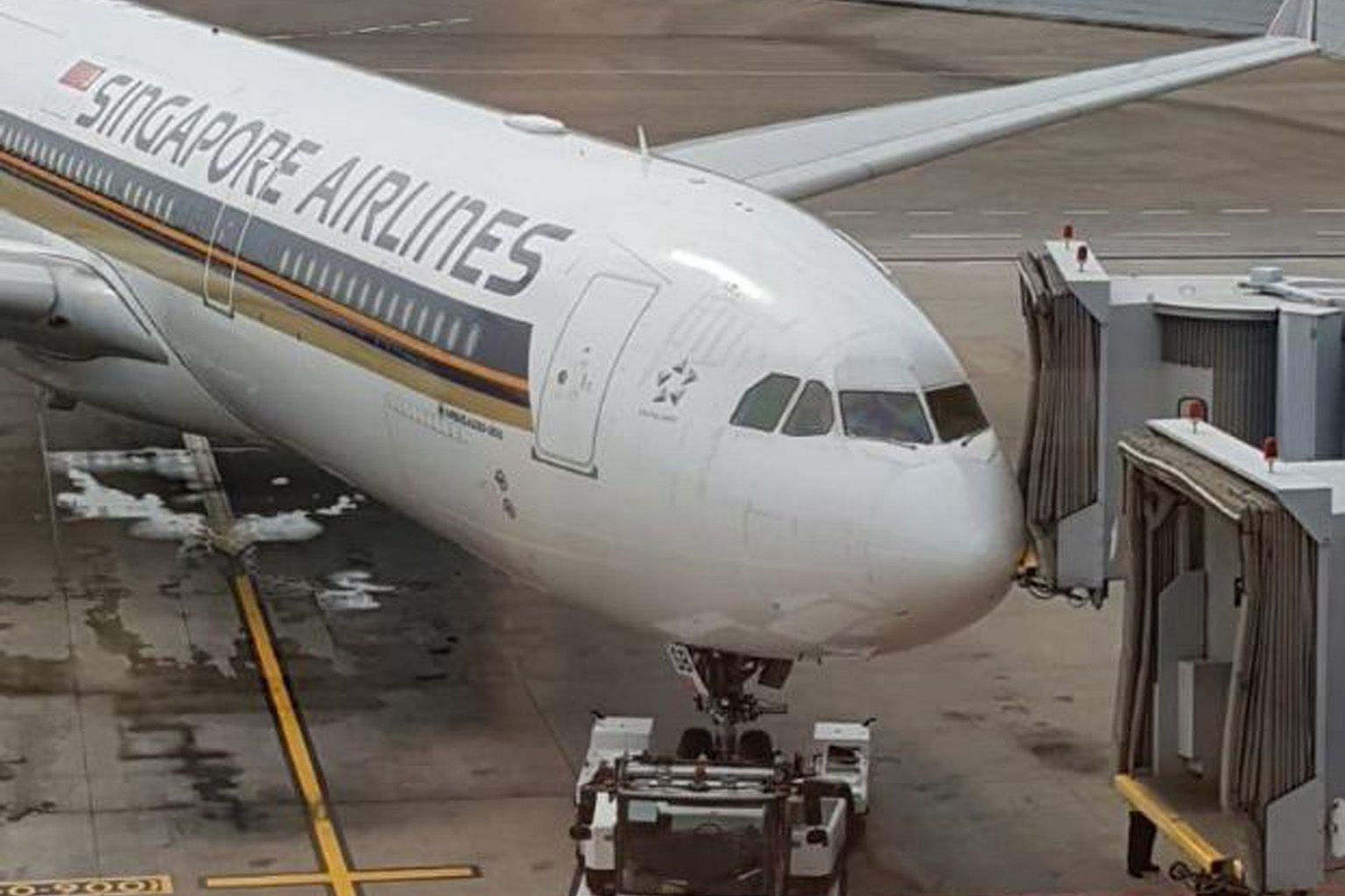 The front body near the nose of the Airbus 330-300 hit one of two aerobridges that were used for boarding on Tuesday.