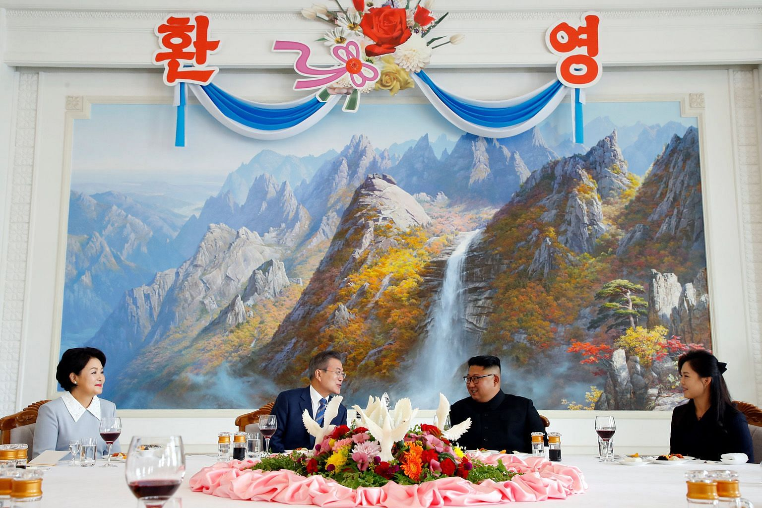 South Korean President Moon Jae-in and his wife Kim Jung-sook having lunch with North Korean leader Kim Jong Un and his wife Ri Sol Ju at Pyongyang's famous cold noodle restaurant Okryukwan yesterday. The two leaders are set to meet again when Mr Kim