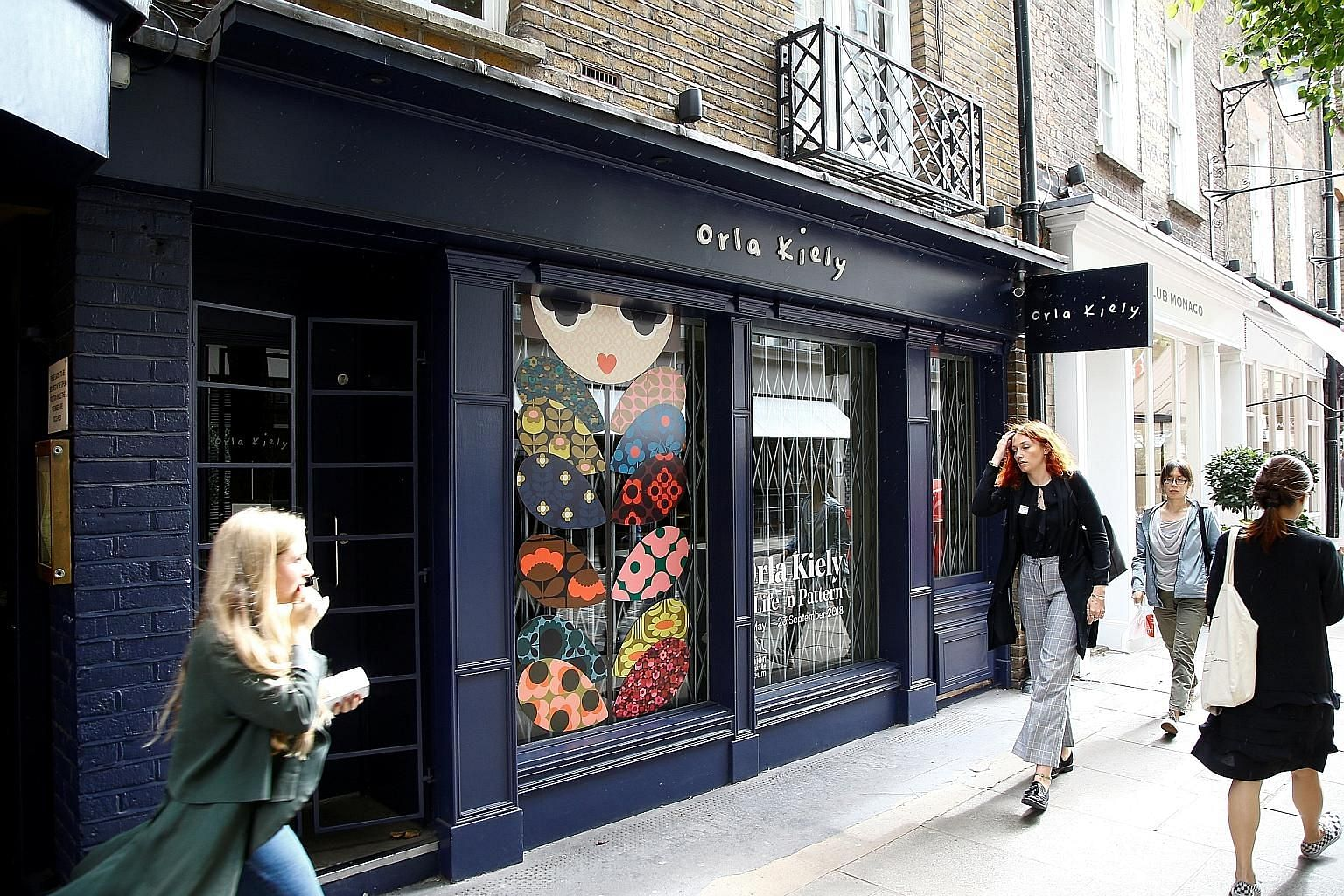 Fashion label Orla Kiely, known for its geometric prints (above), has closed its London store (left).