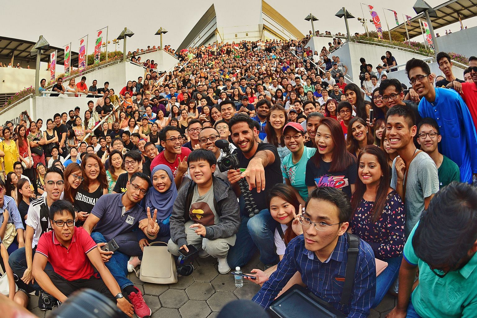 Mr Nuseir Yassin (in front row, wearing a black T-shirt) with his online followers outside the Singapore Indoor Stadium last month.