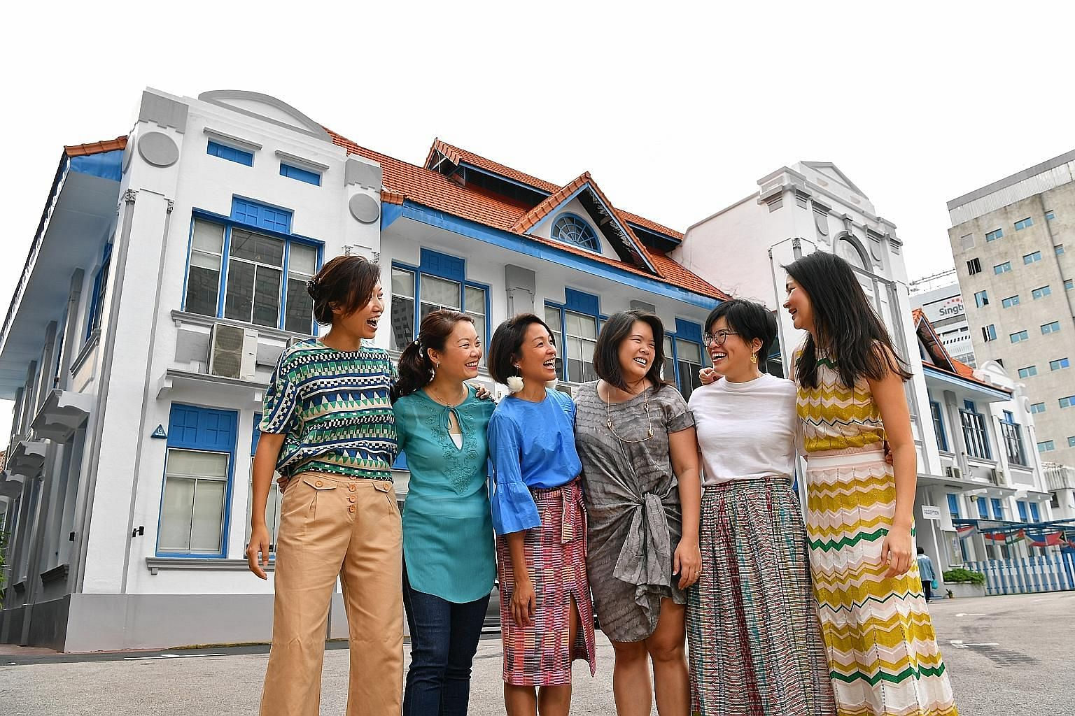 Singapore Chinese Girls' School alumnae (from far left) Daphne Yuan, 34; Lim Swee Keng, 45; Sarah Lin, 35; Melisa Chan, 38; Natalie Kwee, 30; and Jackie Lin, 33, at the site of their old school campus. The team of volunteers launched the campaign to