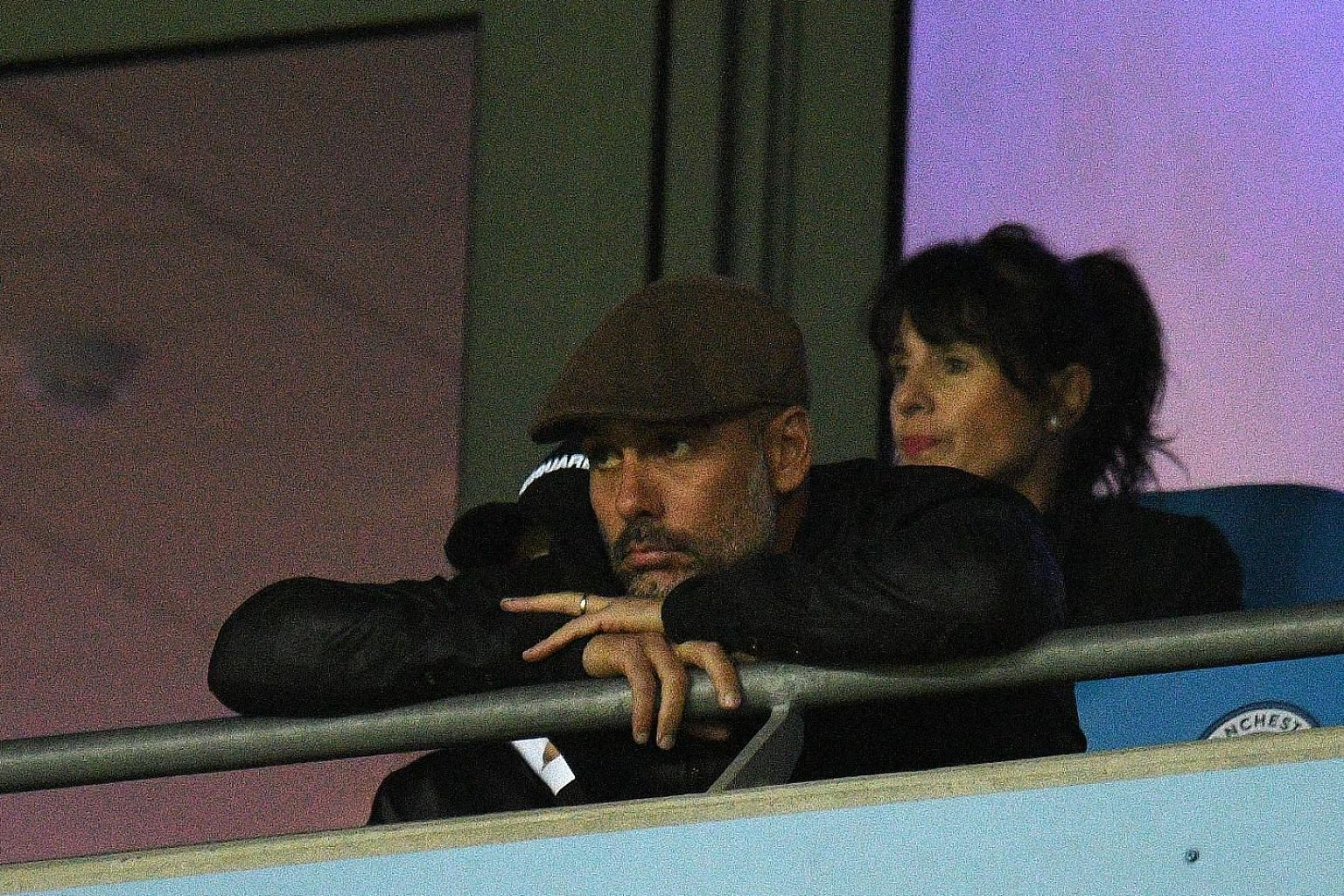 Manchester City's Spanish manager Pep Guardiola cutting a disconsolate figure from the stands during the Champions League match against Lyon at the Etihad Stadium on Wednesday, when the visitors won 2-1.