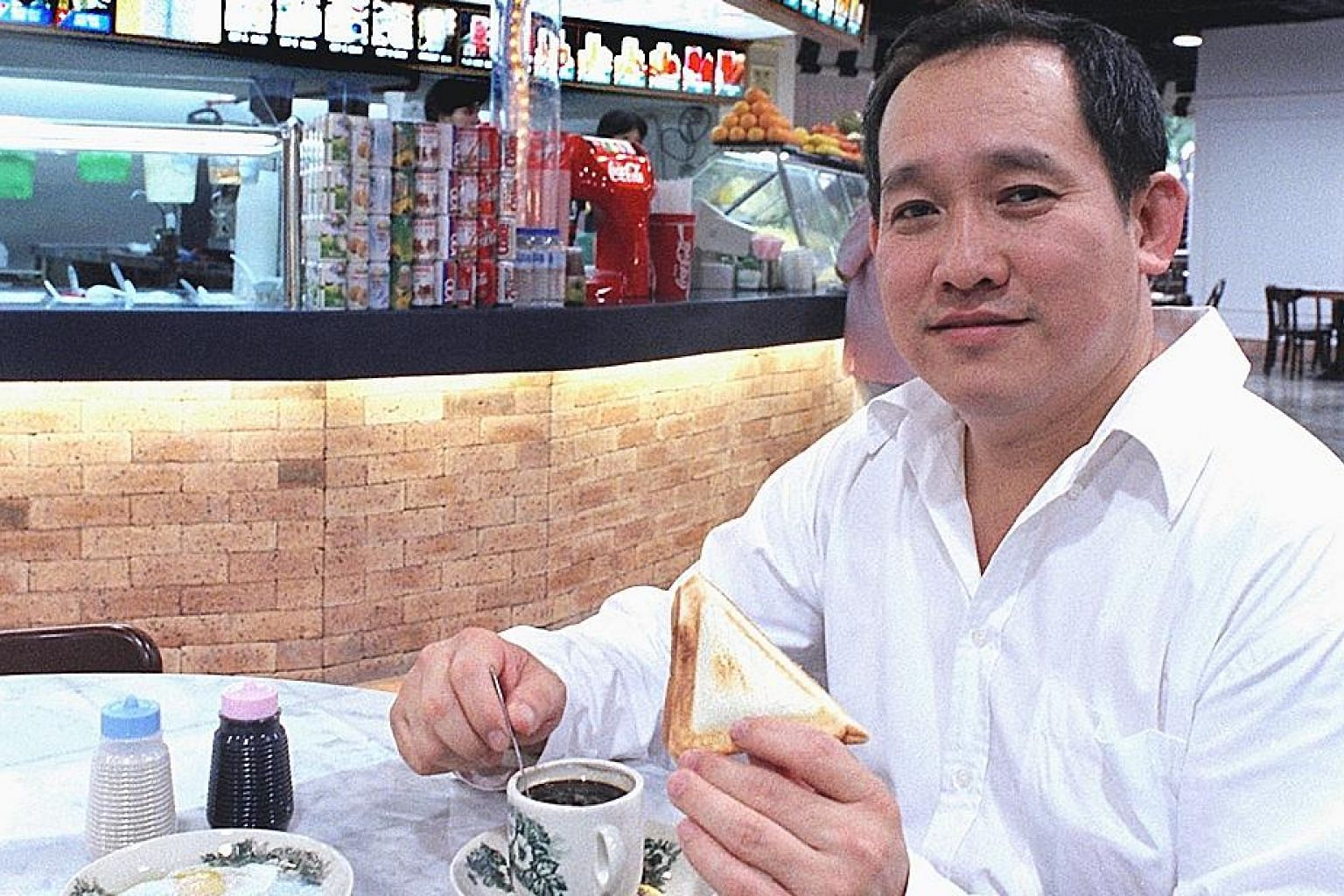 Mr Lim Bee Huat, seen here in an old file photo, started working as a coffee boy when he was nine. Today, his Kopitiam Investment has foodcourts, coffee shops and hawker centres islandwide, including flagship outlet Lau Pa Sat.