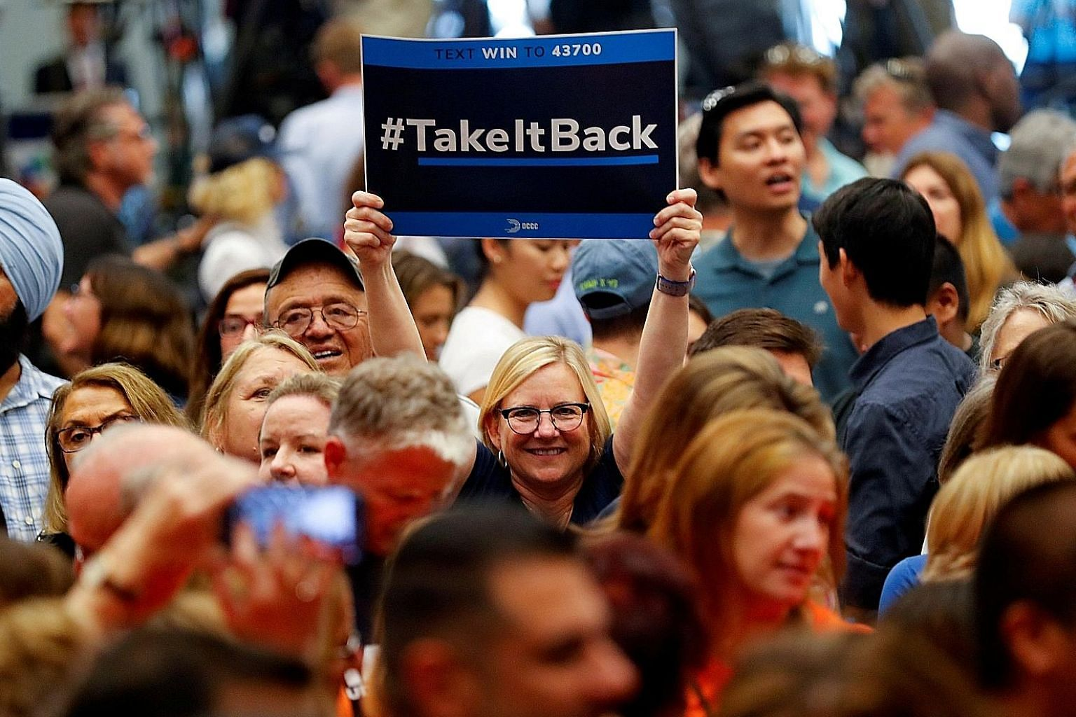 Supporters at a political rally with former president Barack Obama for Democratic California candidates in Anaheim, California, on Sept 8. Democrats are expected to take back the House of Representatives in the mid-terms.