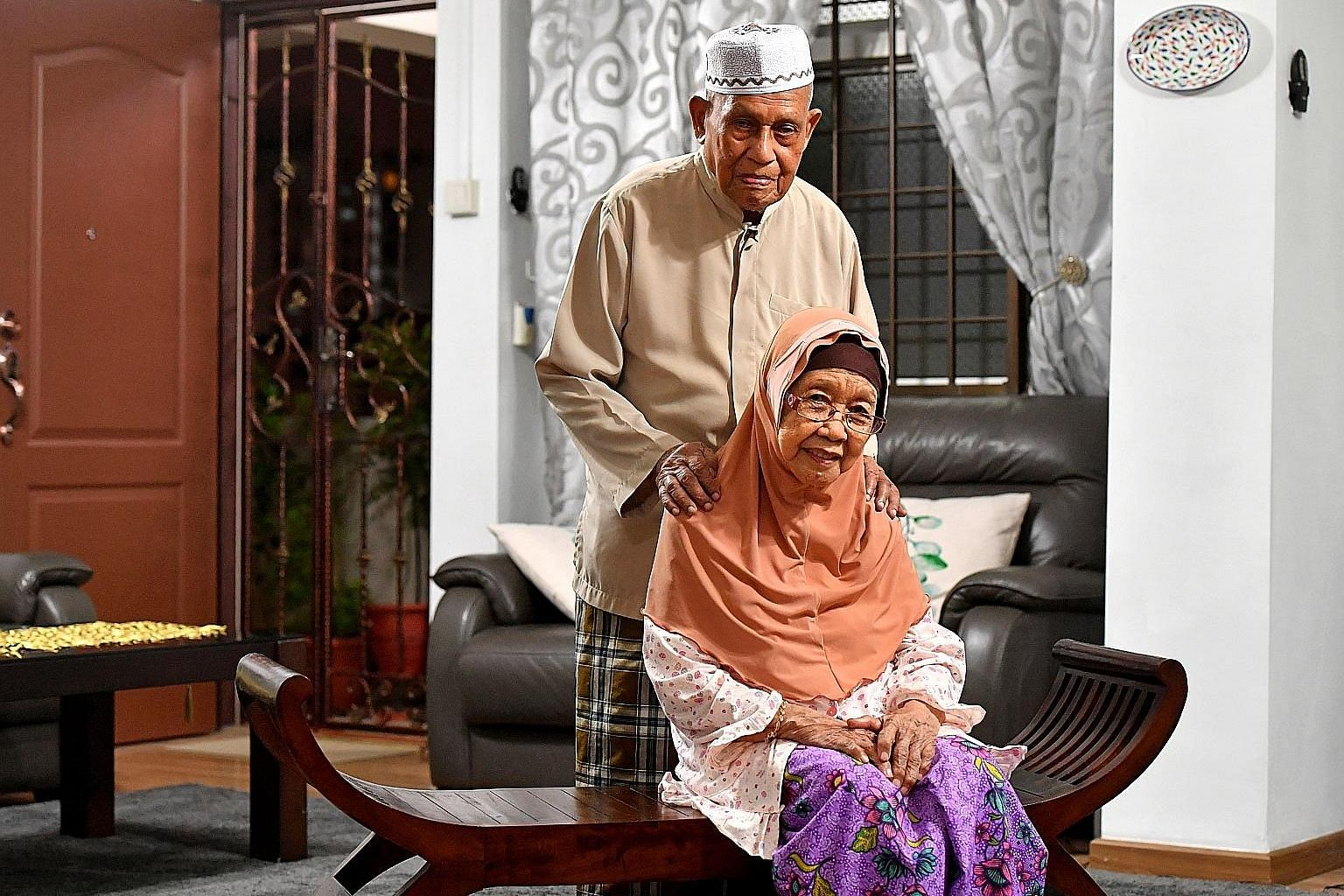 Mr Kassim and Madam Tuminah (seated in the middle of the sofa) with their 12 children. Having many children has helped to bond the family for Haji Kassim Sultan, 98, and Hajah Tuminah Haji Siraj, 88. They have been married for 73 years.