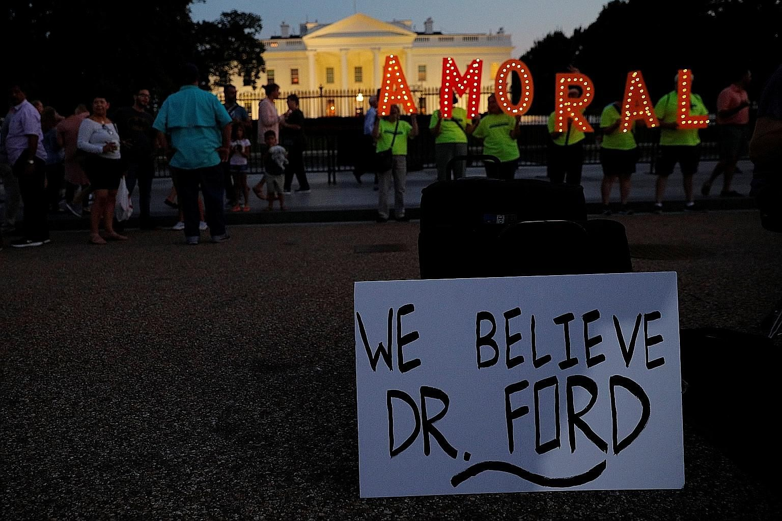 Protesters outside the White House last week with a sign supporting Dr Christine Blasey Ford, who has accused Judge Brett Kavanaugh (above), President Donald Trump's Supreme Court nominee, of sexually assaulting her in the 1980s when they were teenag